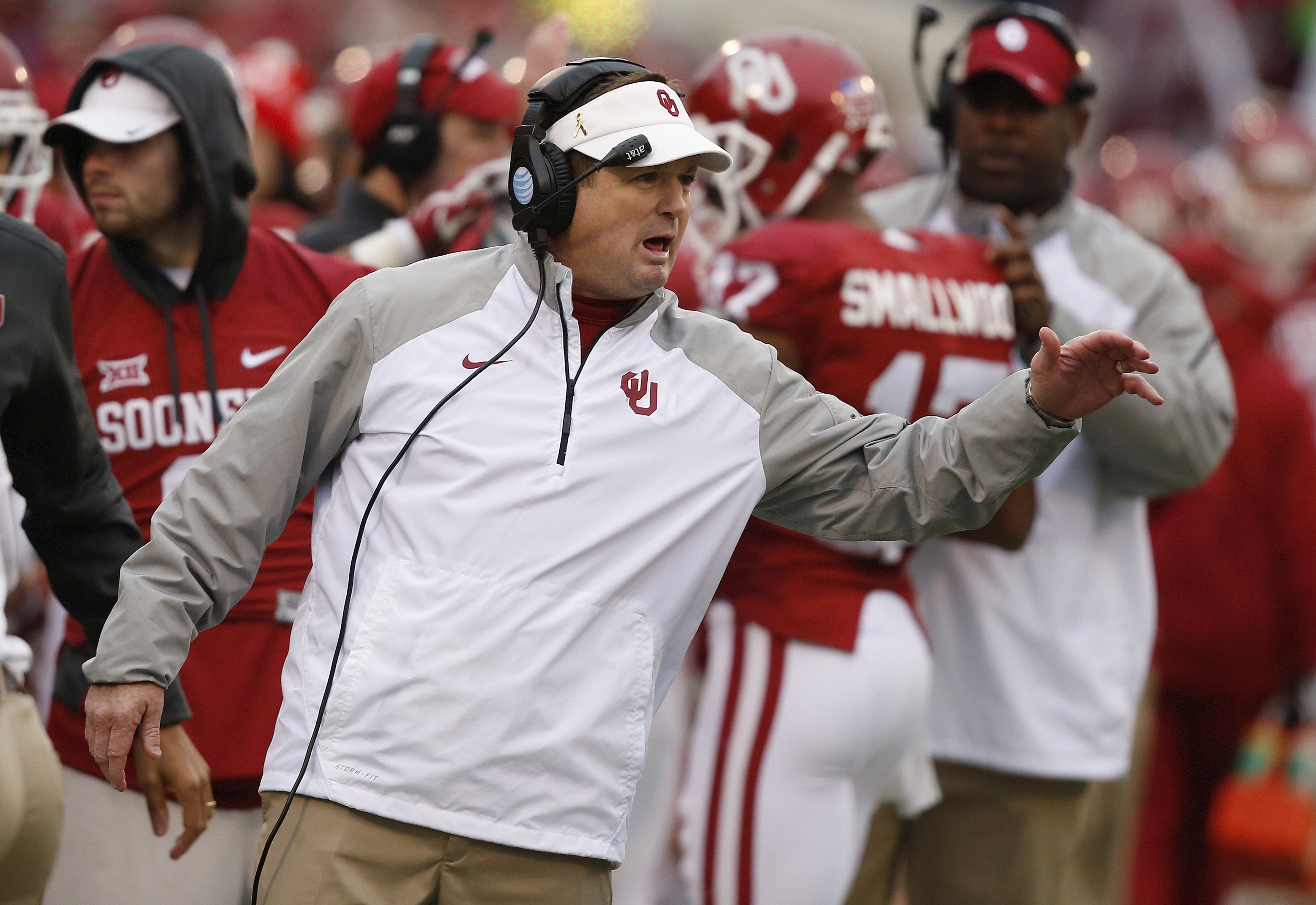 FILE - In this Dec. 6, 2014 file photo, Oklahoma head coach Bob Stoops is shown during an NCAA college football game between Oklahoma State and Oklahoma in Norman, Okla. Oklahoma already has a record nine Big 12 championships, and last season took the lea