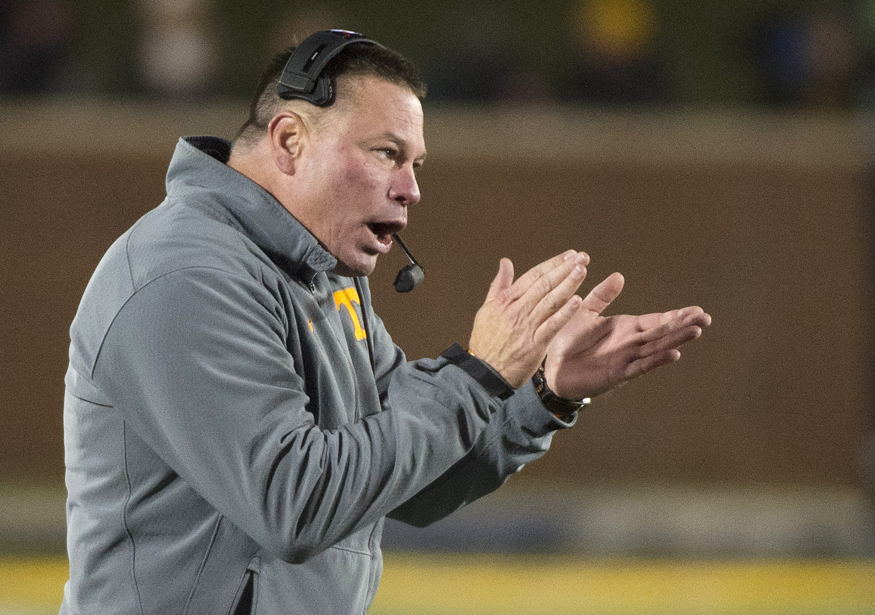 FILE - In this Nov. 21, 2015, file photo, Tennessee head coach Butch Jones encourages his players during the first quarter of an NCAA college football game against Missouri in Columbia, Mo. Under a new NCAA rule change that took effect last week, athletic