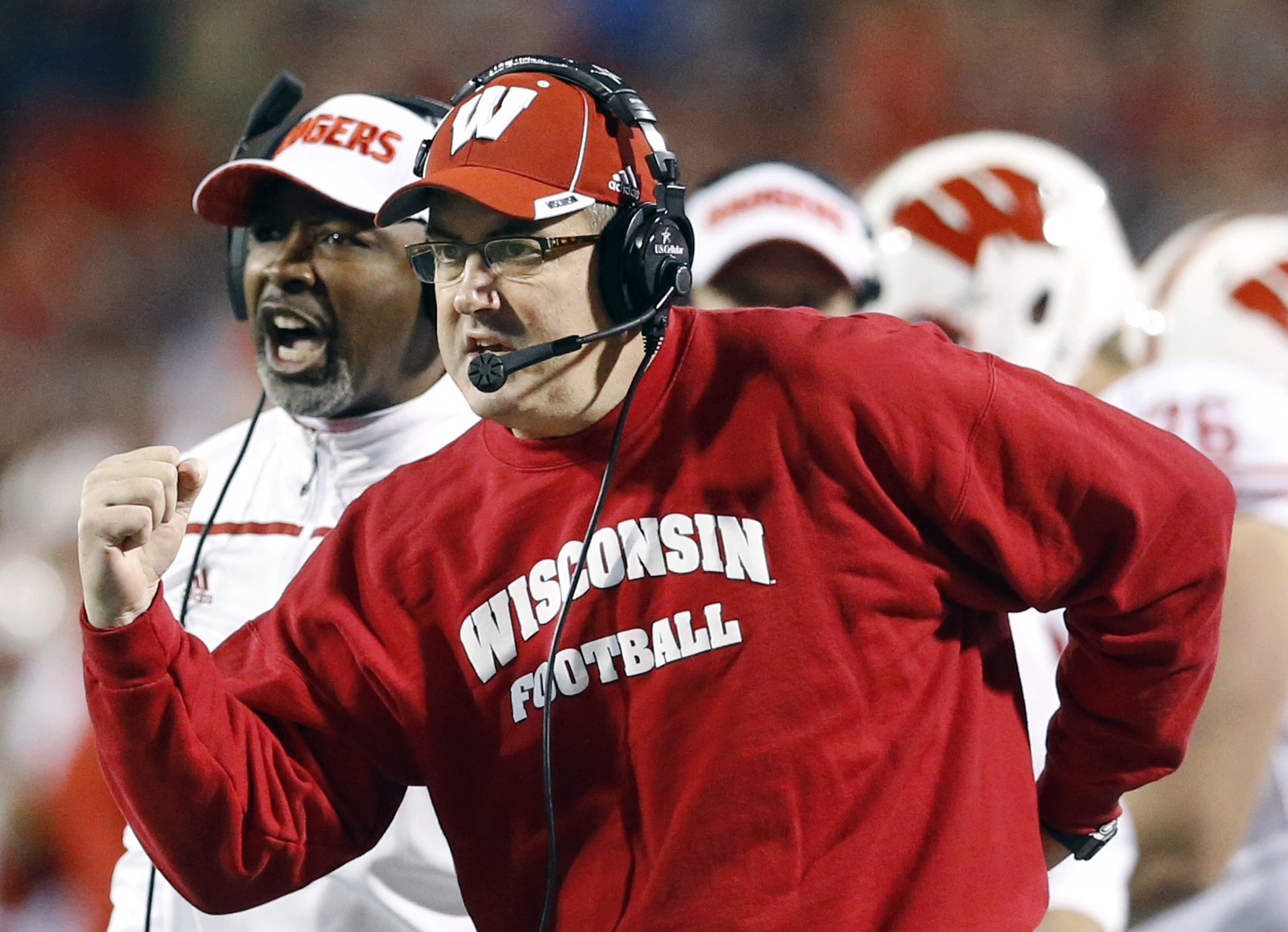 FILE - In this Nov. 7, 2015, file photo, Wisconsin head coach Paul Chryst, foreground, reacts after running back Alec Ingold scored a touchdown in the second half of an NCAA college football game against Maryland. Wisconsin has to play national powers LSU
