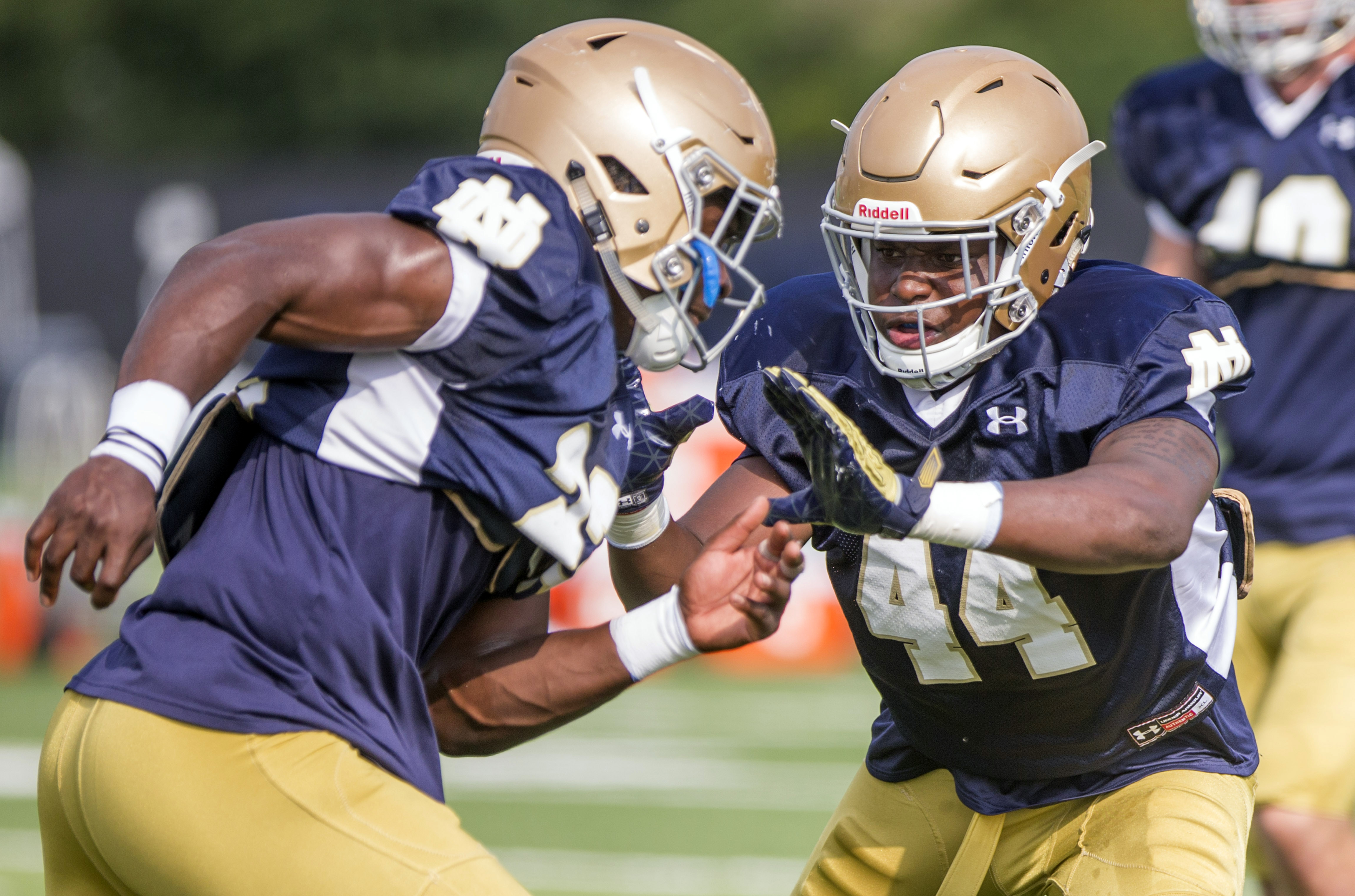 Notre Dame linebackers Asmar Bilal (22) and Jamir Jones (44) run drills during NCAA college football practice Thursday, Aug. 11, 2016, in South Bend, Ind. (Robert Franklin/South Bend Tribune via AP)