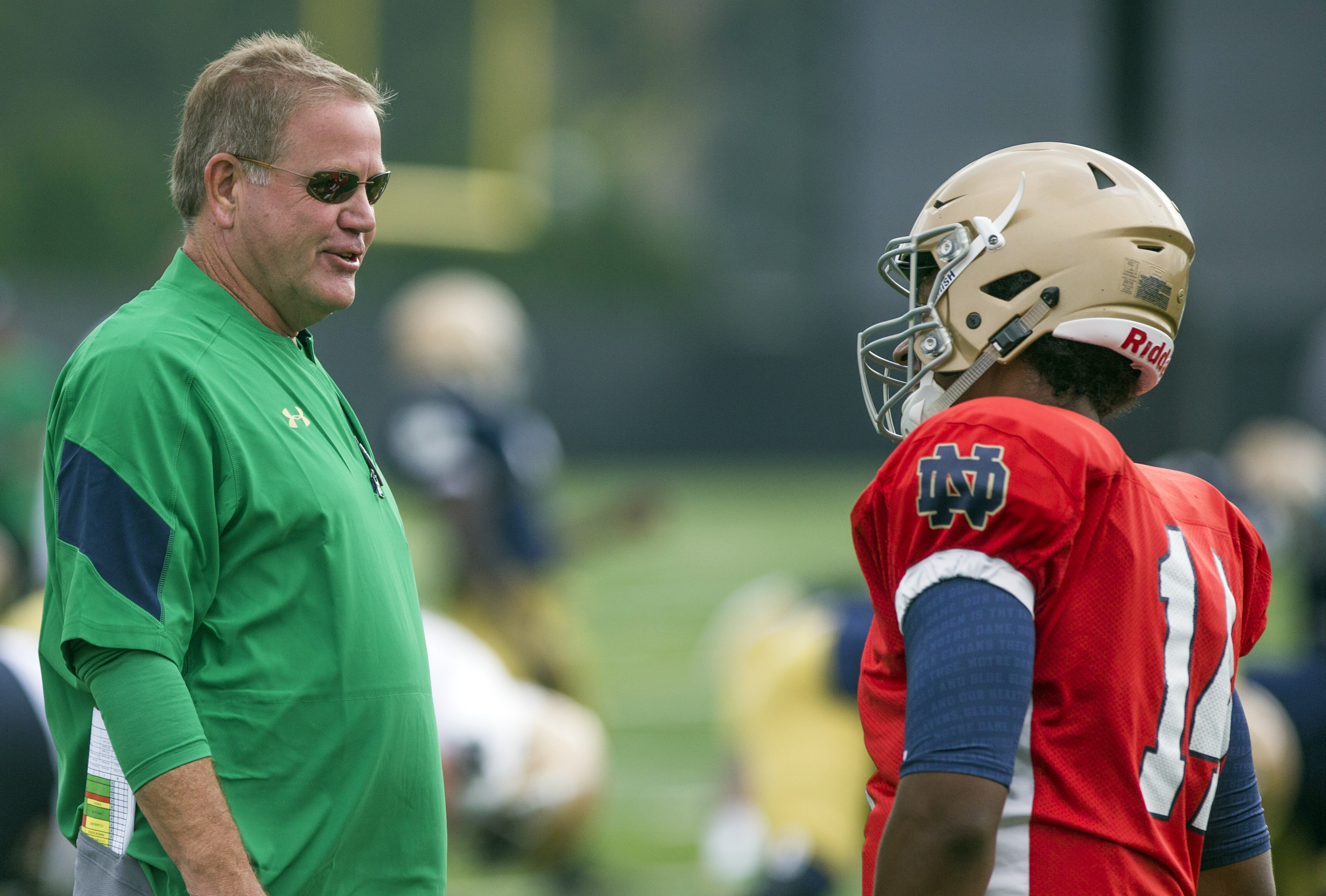 Notre Dame head coach Brian Kelly, left, and quarterback DeShone Kizer talk during NCAA college football practice Thursday, Aug. 11, 2016, in South Bend, Ind. (Robert Franklin/South Bend Tribune via AP)