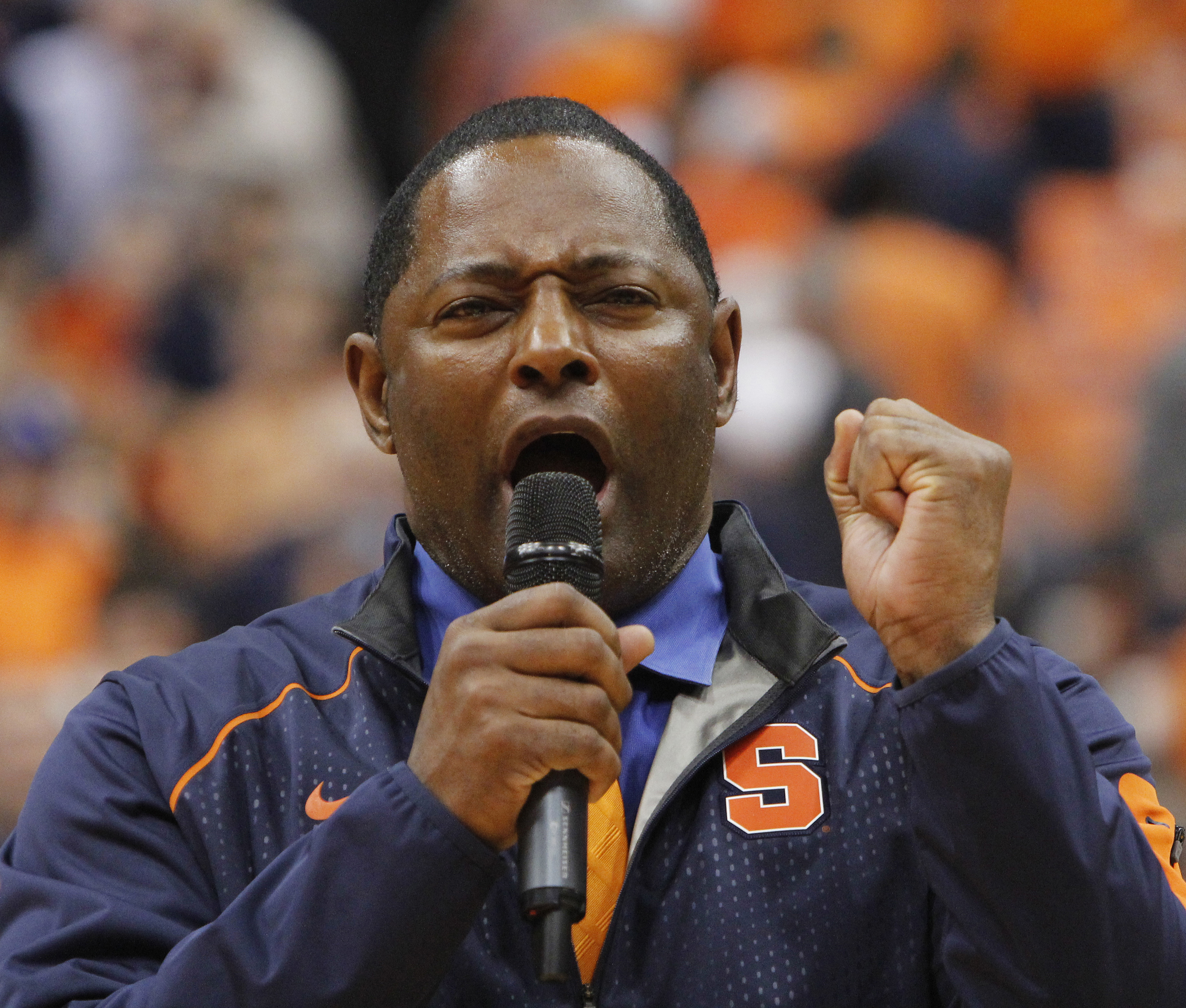 FILE - In this Jan. 9, 2016, file photo, Syracuses new head football coach Dino Babers addresses the crowd at the Carrier Dome during half time of an NCAA college basketball game Syracuse against North Carolina in Syracuse, N.Y. Babers hasnt made any bold