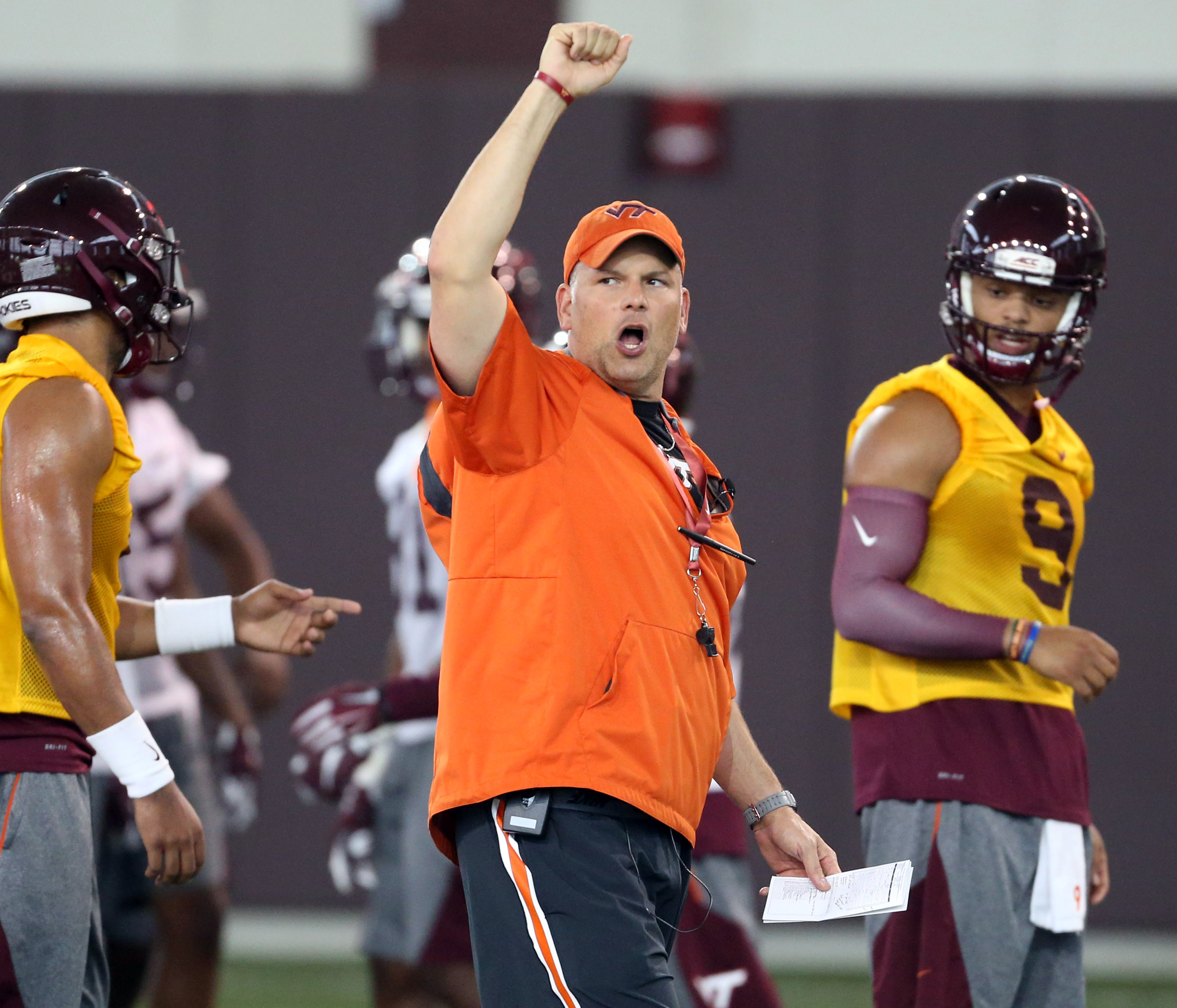 FILE- In this Thursday, Aug. 4, 2016, file photo, Virginia Tech head coach Justin Fuente directs offensive drills as quarterbacks Jerod Evans (4) left, and Brenden Motley (9) right, listen during NCAA college football practice in Blacksburg, Va. Replacing
