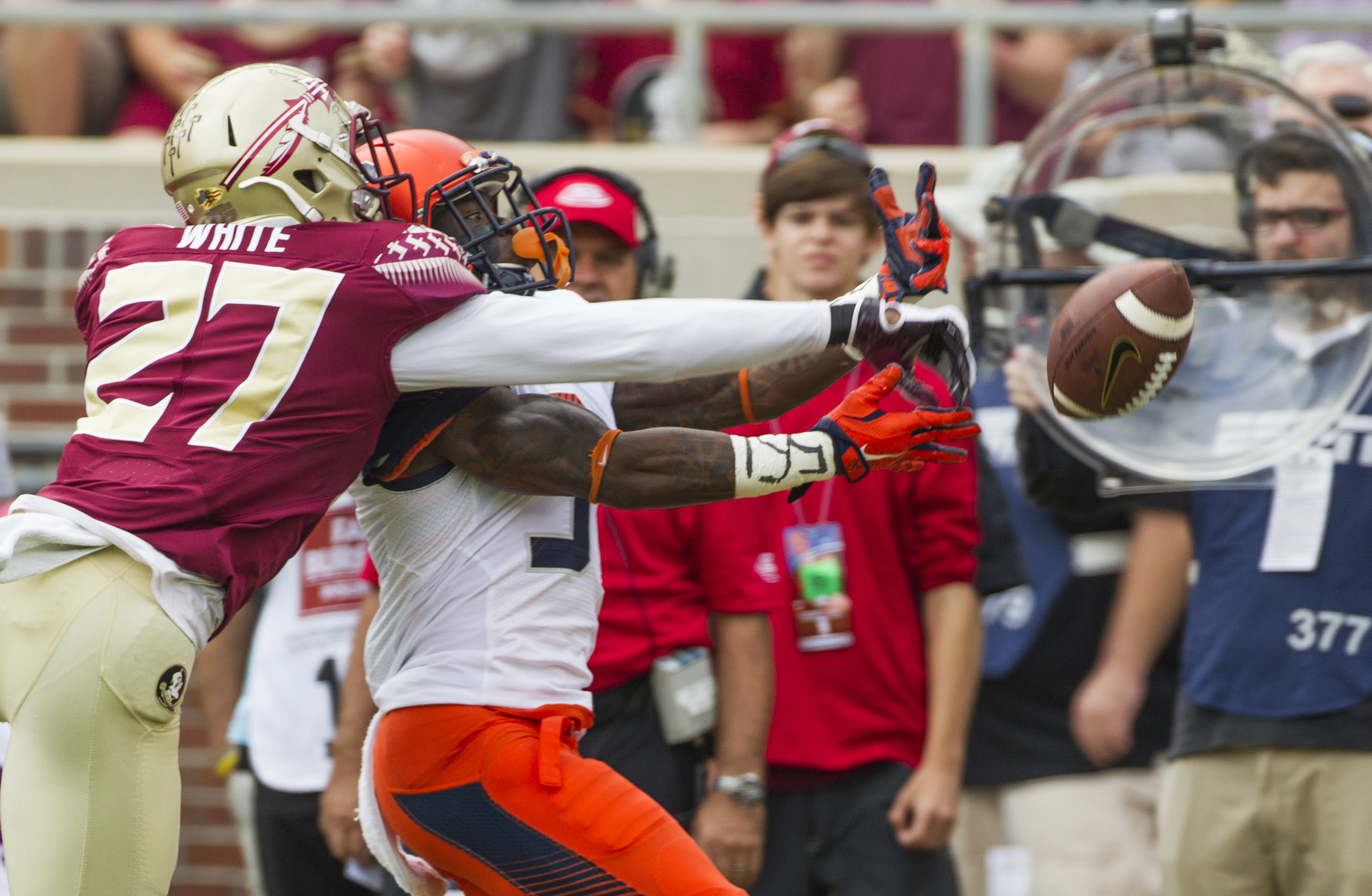 FILE - In this Oct. 31, 2015, file photo, Florida State defensive back Marquez White deflects a pass intended for Syracuse Brisly Estime in the first half of an NCAA college football game in Tallahassee, Fla. White has been in the shadows of Jalen Ramsey