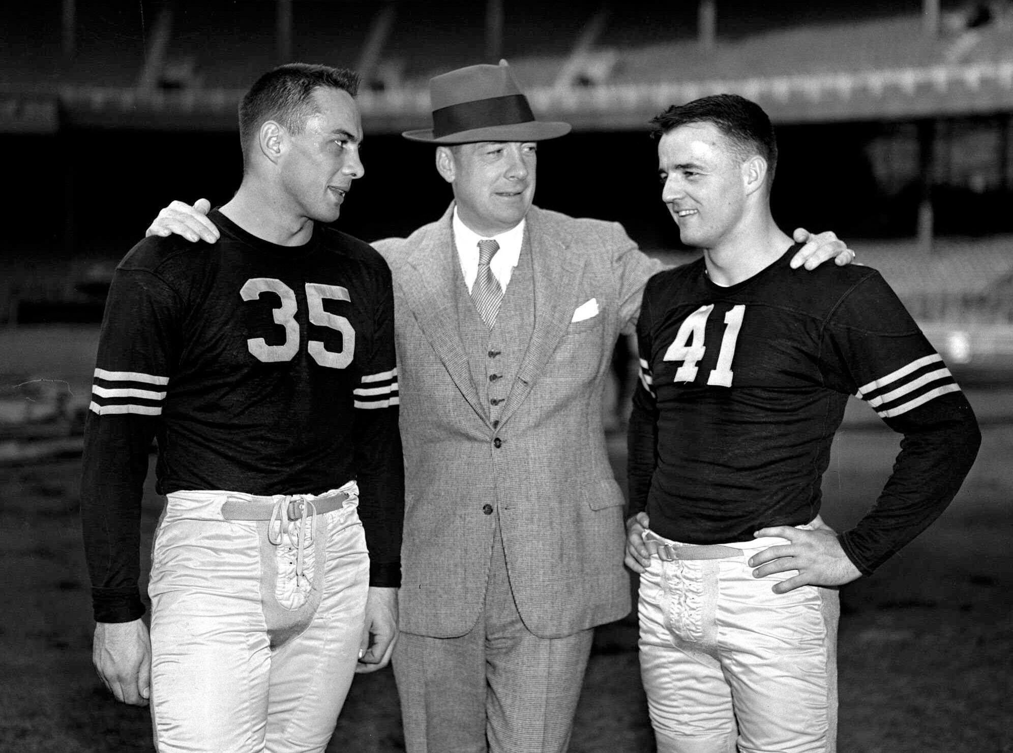 FILE -  In this Oct. 25, 1946, file photo, Army football coach Earl Blaik, center, stands with his co-captains Felix Blanchard, left, and Glenn Davis, at the Polo Grounds, in New York. Blanchard and Davis won the first Heisman Trophies in Army football hi