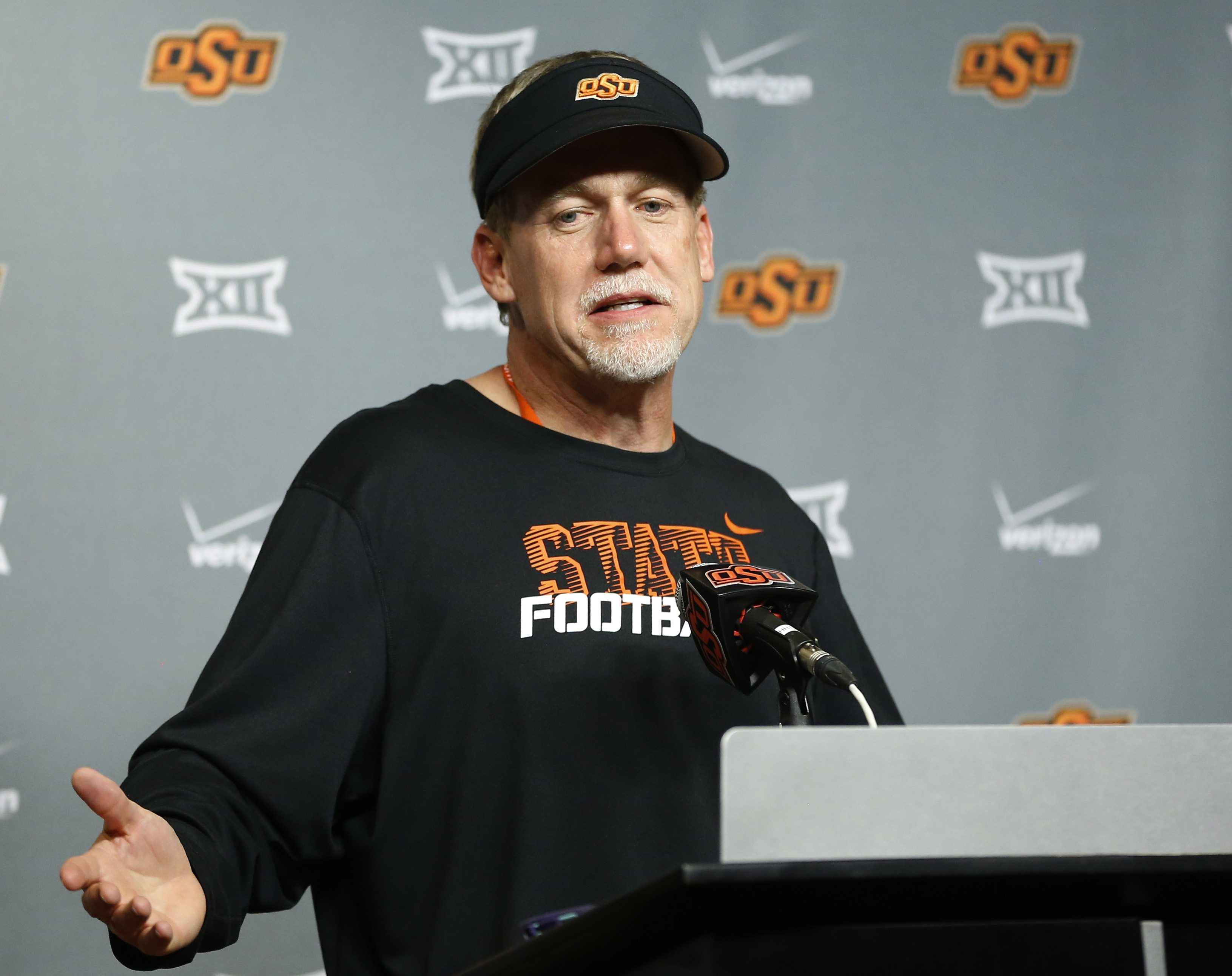 FILE - In this April 18, 2015, file photo, Oklahoma State defensive coordinator Glenn Spencer answers a question during a news conference following the Oklahoma State NCAA college spring football game Stillwater, Okla. Buried amid the excitement of compet