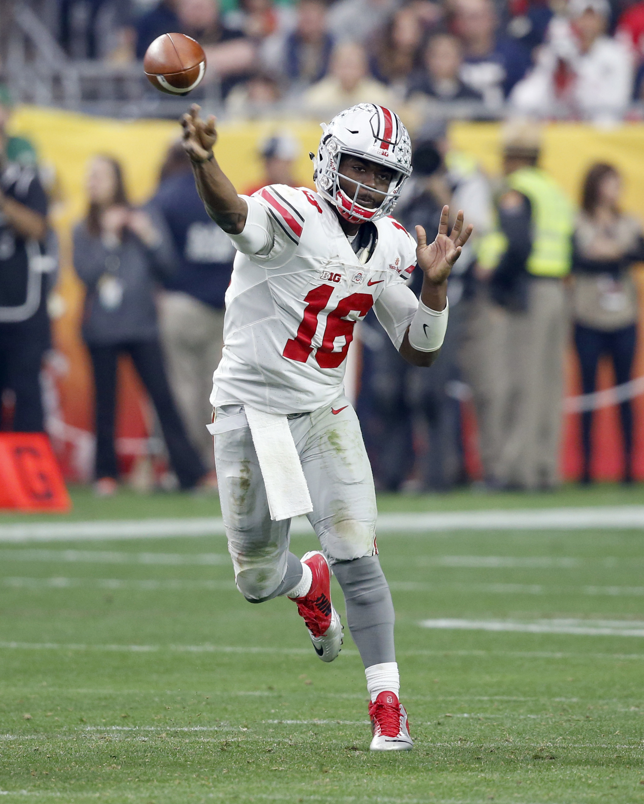 FILE - In this Jan. 1, 2016, file photo, Ohio State quarterback J.T. Barrett (16) throws against Notre Dame during the second half of the Fiesta Bowl NCAA College football game, in Glendale, Ariz. Last year,  Barrett was beaten out by Cardale Jones in the