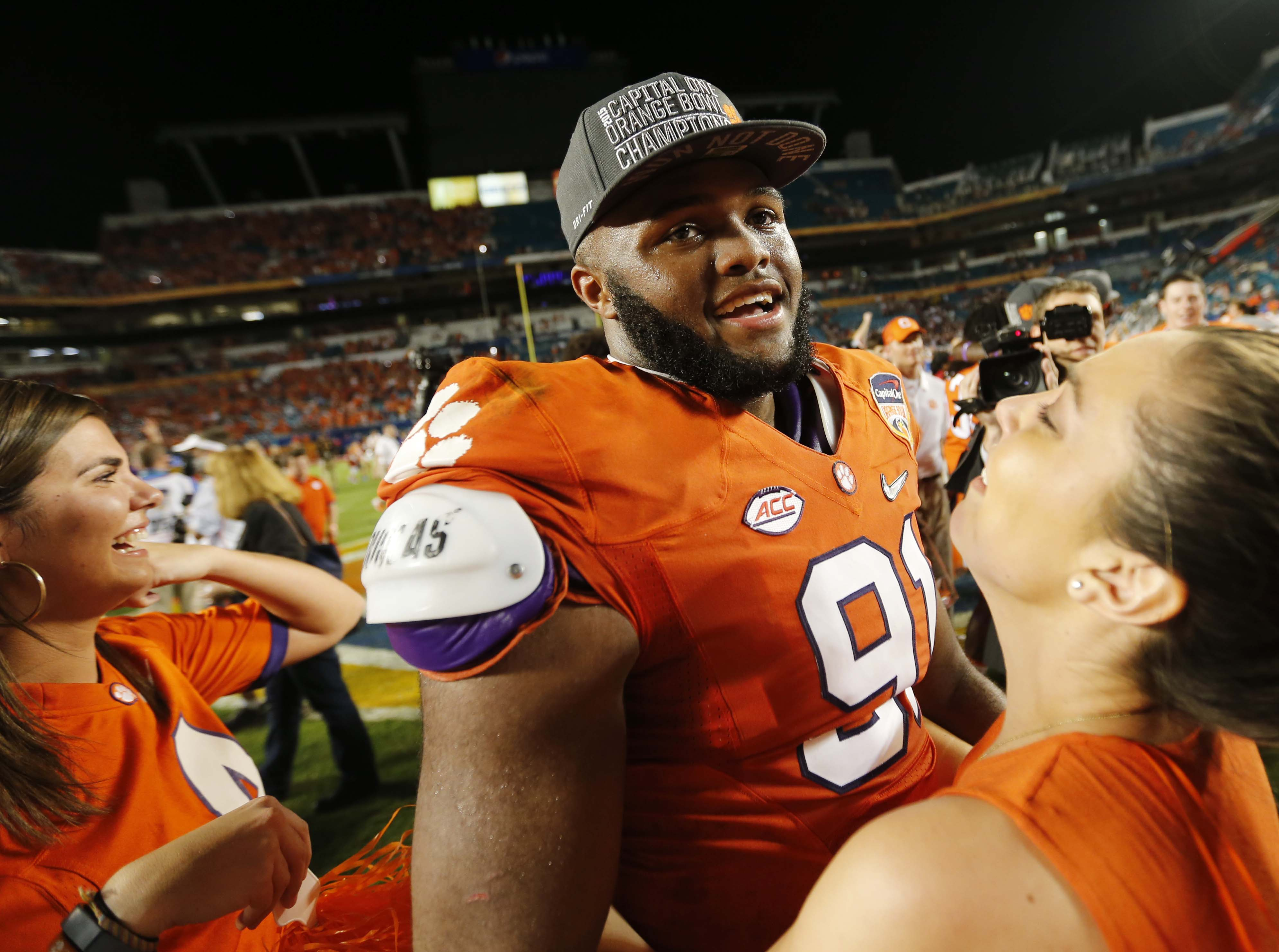 Clemson defensive lineman Austin Bryant (91) is congratulated on the field after his team won the Orange Bowl NCAA college football semifinal playoff game against Oklahoma, Thursday, Dec. 31, 2015, in Miami Gardens, Fla. Clemson defeated Oklahoma 37-17. (