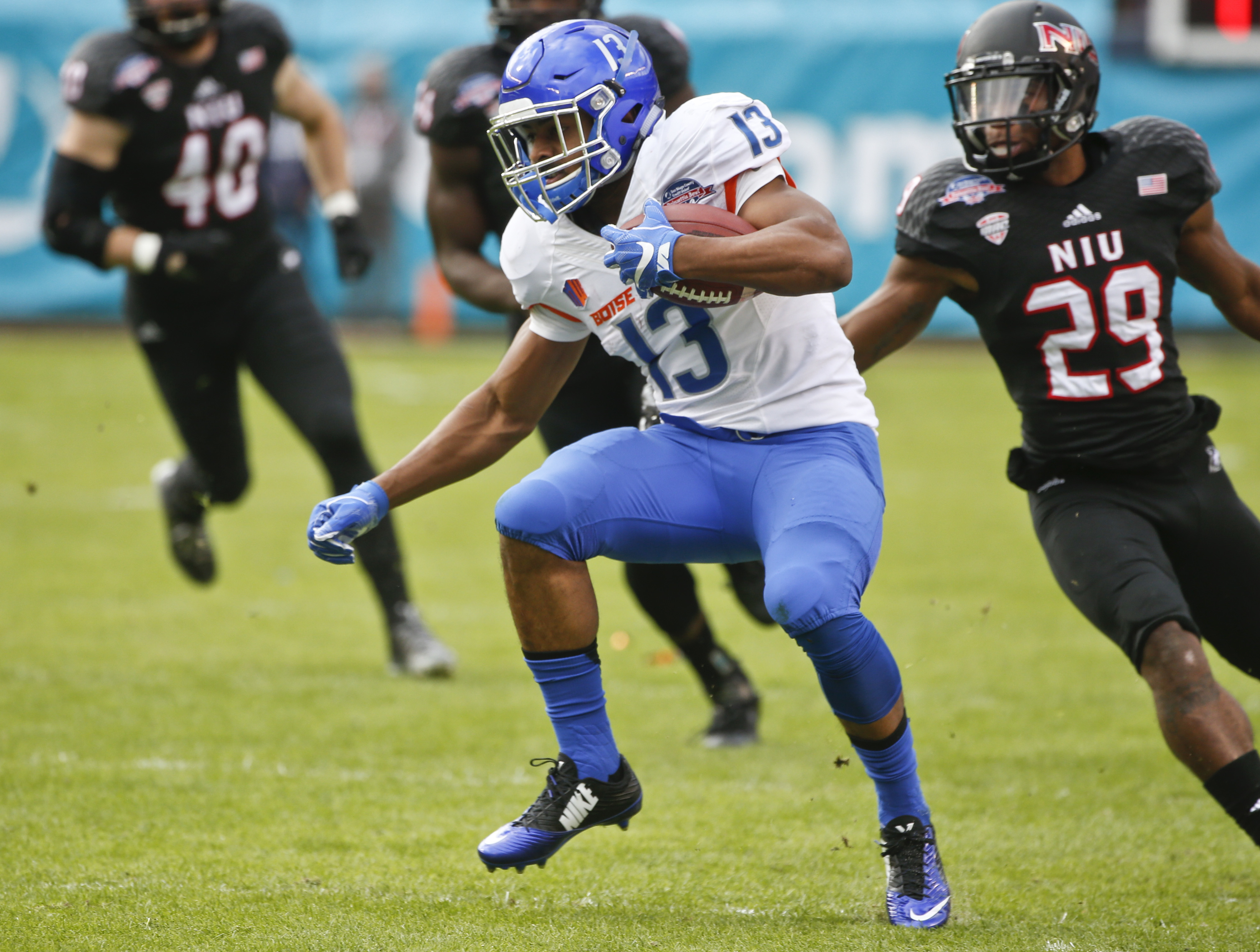 FILE -- In this Dec. 23, 2015, file photo, Boise State running back Jeremy McNichols maneuvers through the Northern Illinois defense with a pass reception during the first half of the Poinsettia Bowl NCAA college football game in San Diego. (AP Photo/Lenn