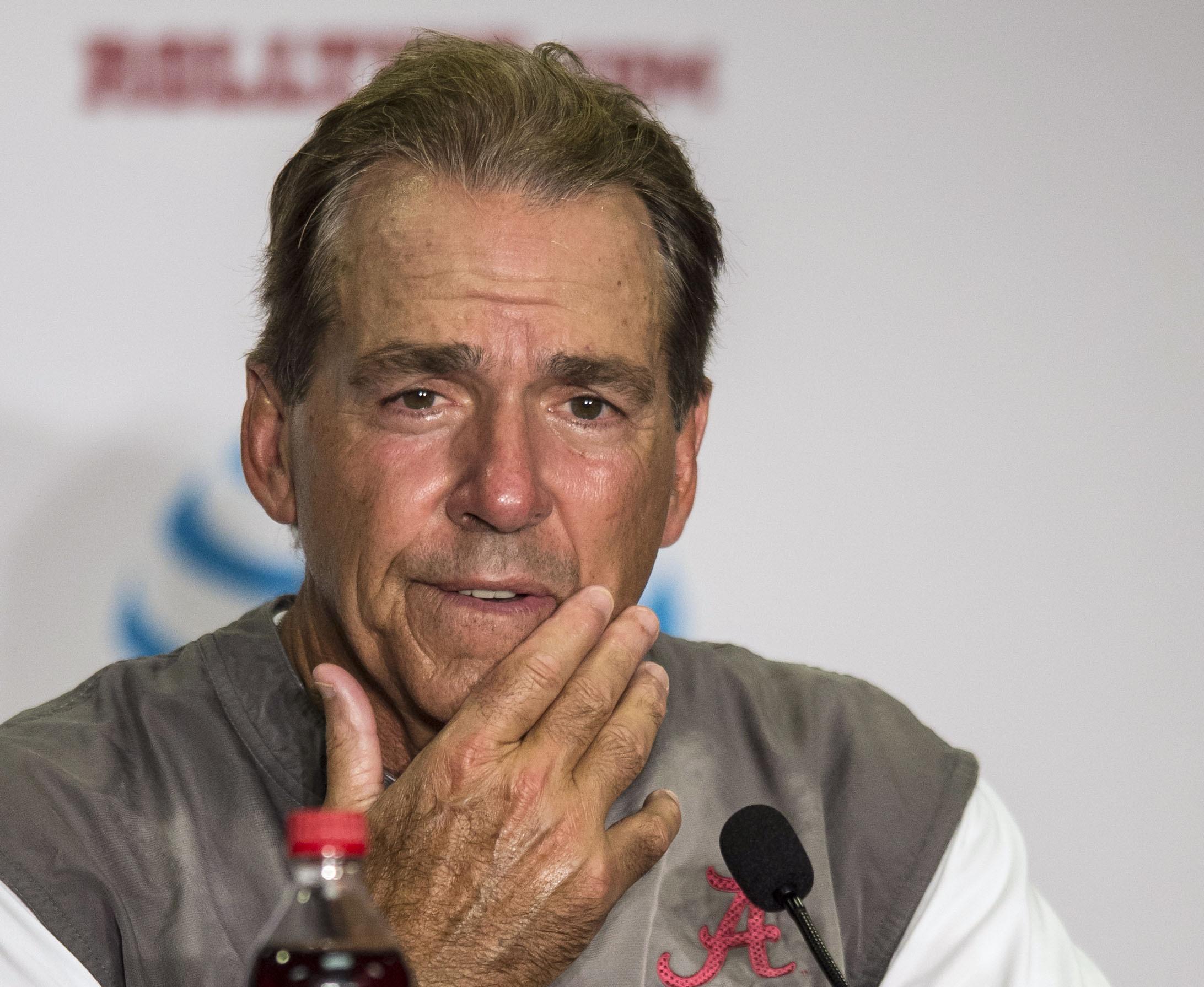Alabama coach Nick Saban talks with reporters after the NCAA college football team's scrimmage  Saturday, Aug. 20, 2016, in Tuscaloosa, Ala. (Vasha Hunt/AL.com via AP)