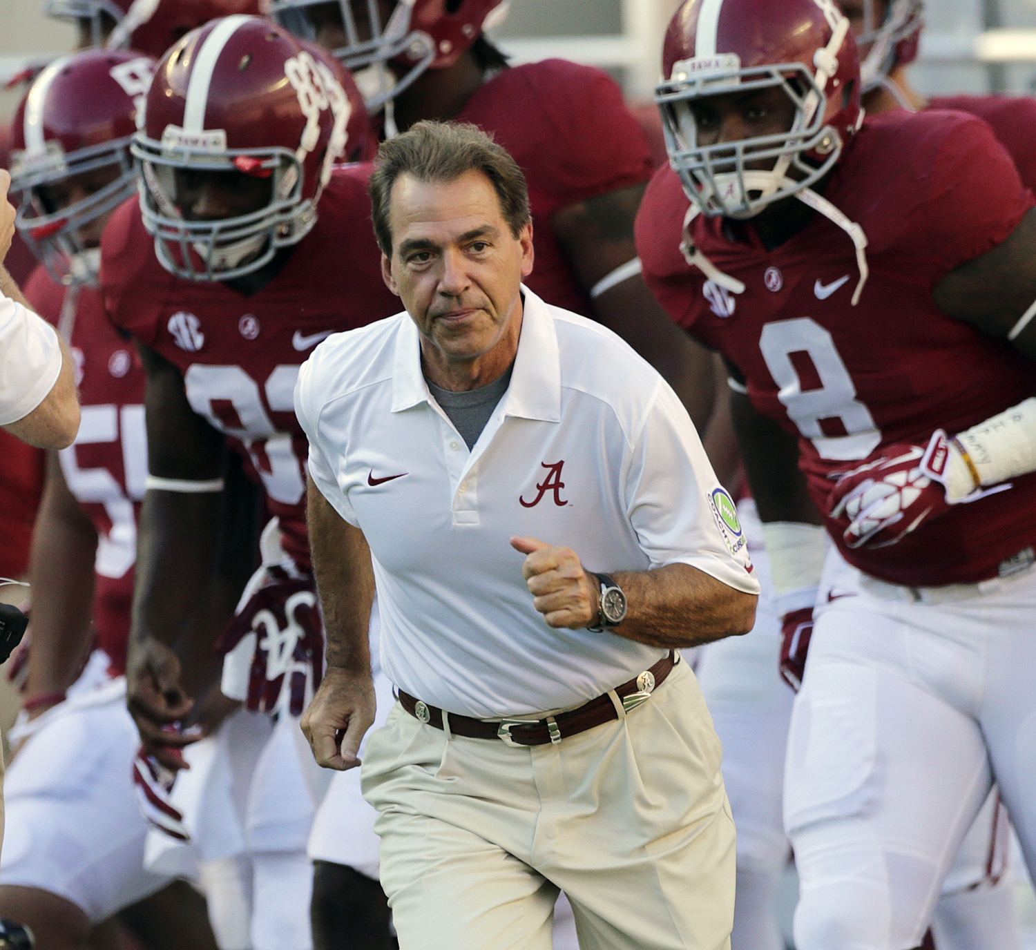 FILE - In this Sept. 28, 2013, file photo, Alabama head coach Nick Saban leads his team onto the field prior to an NCAA college football game against Mississippi in Tuscaloosa, Ala. The defending national champion Crimson Tide is the No. 1 team in The Ass