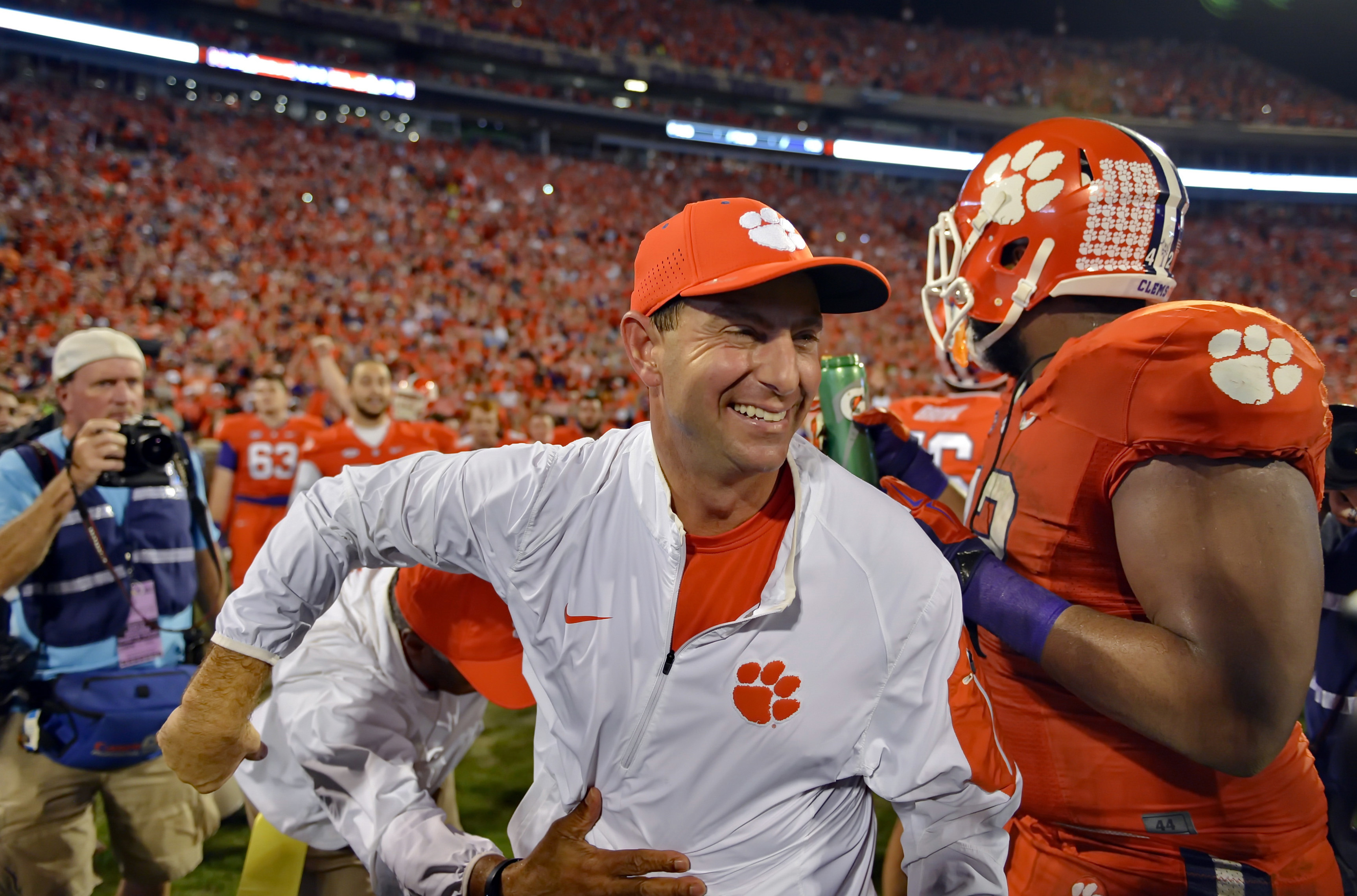 FILE - In this Nov. 7, 2015, file photo, Clemson head coach Dabo Swinney celebrates after their 23-17 win over Florida State in an NCAA college football game in Clemson, S.C. Alabama is No. 1 in The Associated Press preseason Top 25. Clemson is No. 2. (AP