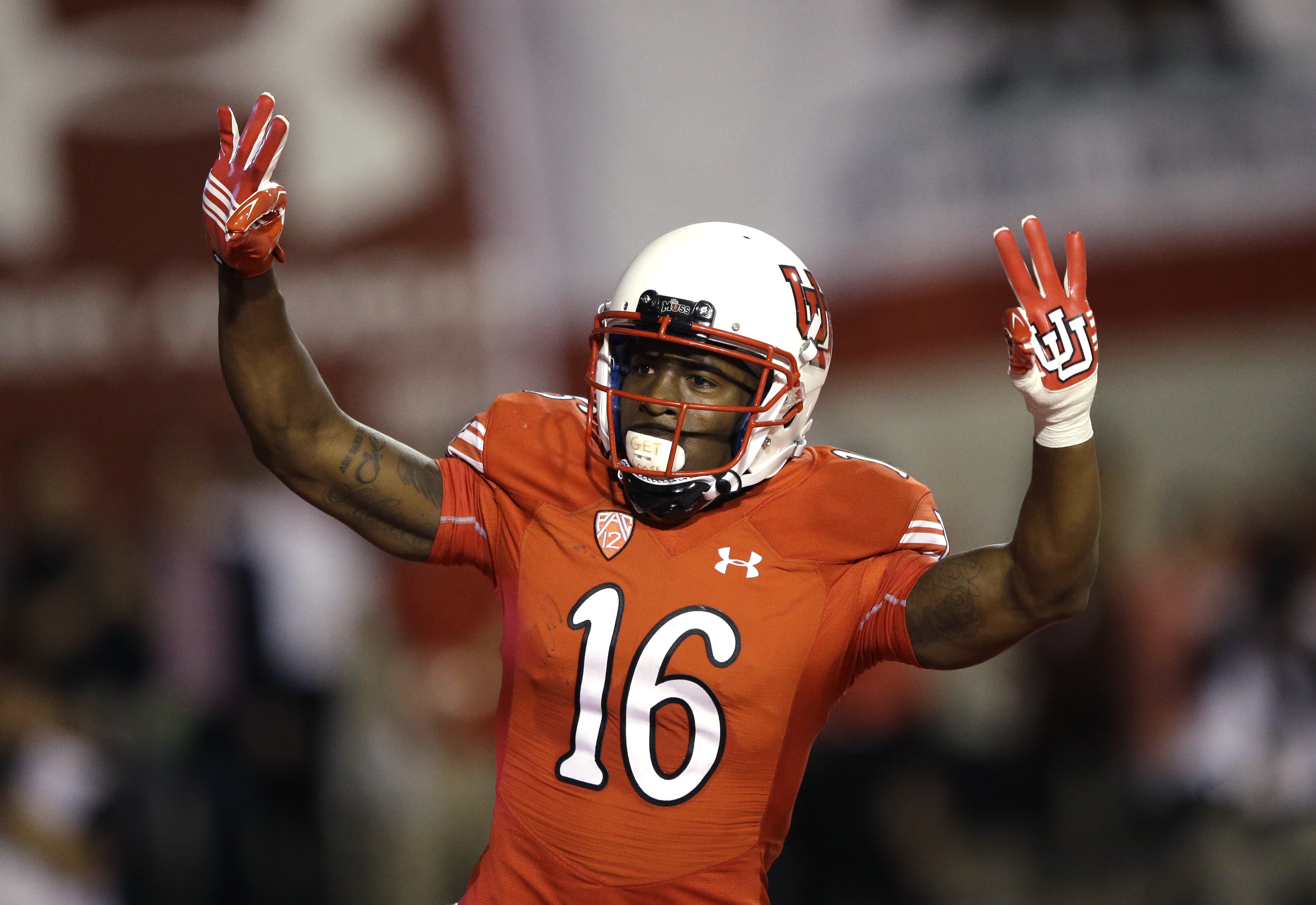FILE - In this Oct. 10, 2015, file photo, Utah's Cory Butler-Byrd celebrates after scoring against California during an NCAA college football game in Salt Lake City. Suspended Utah receiver Butler-Byrd has pleaded guilty to a misdemeanor charge of crimina
