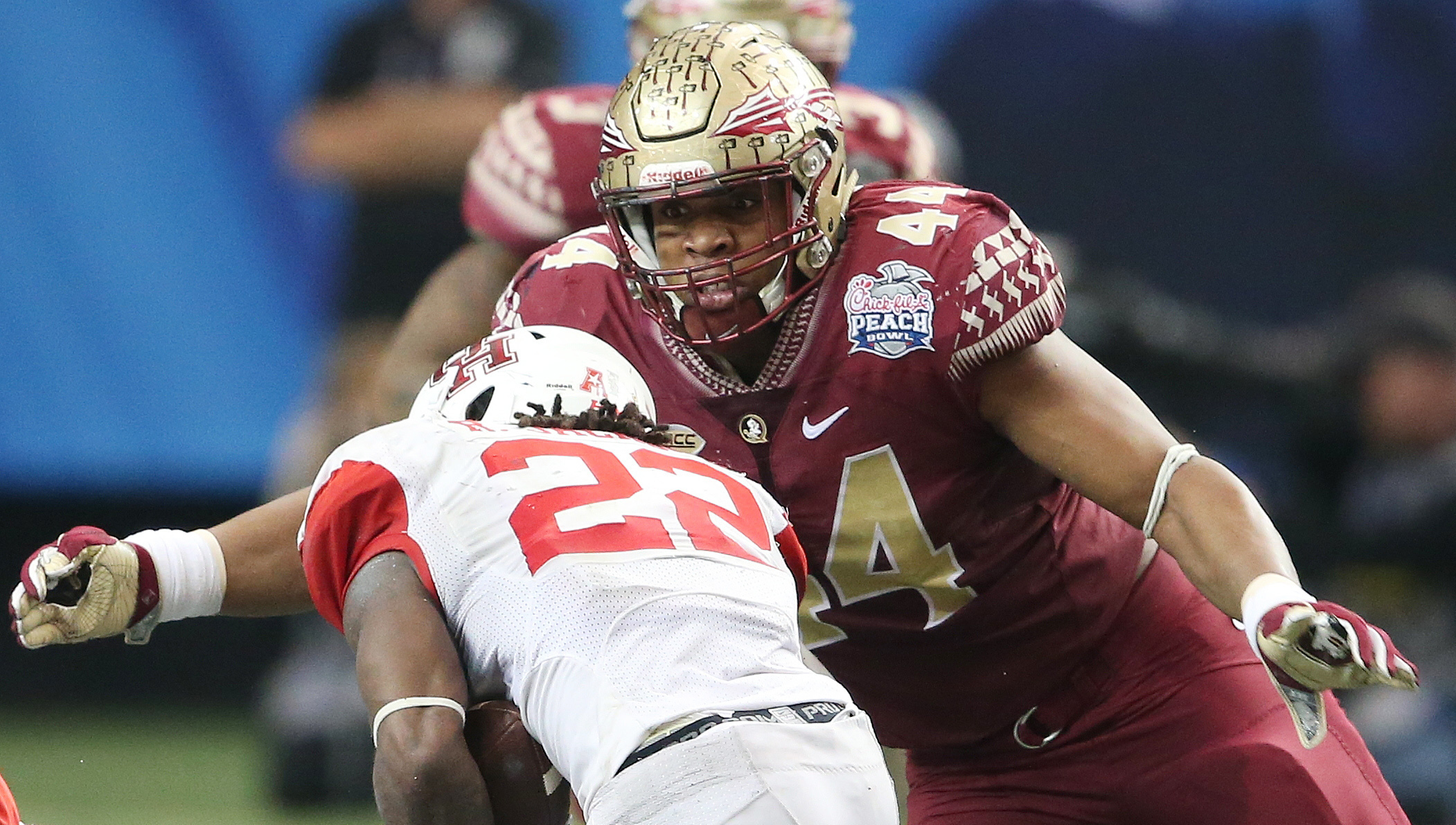 FILE- In this Dec. 31, 2016, file photo, Florida State defensive end DeMarcus Walker (44) prepares to hit Houston running back Ryan Jackson (22) during the second half of the Peach Bowl NCAA college football game, in Atlanta. After having 10.5 sacks last