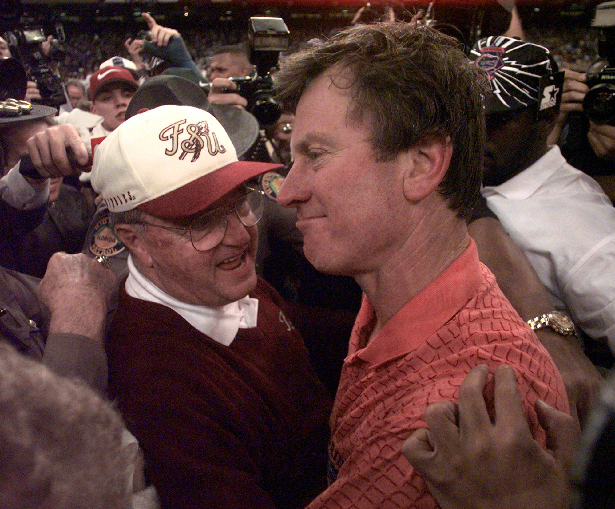 FILE - In this Jan. 2, 1997, file photo, Florida State Seminoles coach Bobby Bowden, left, congratulates Florida Gators coach Steve Spurrier after the Gators won 52-20 in the Sugar Bowl at the Superdome in New Orleans. The Gators and Seminoles met 12 time