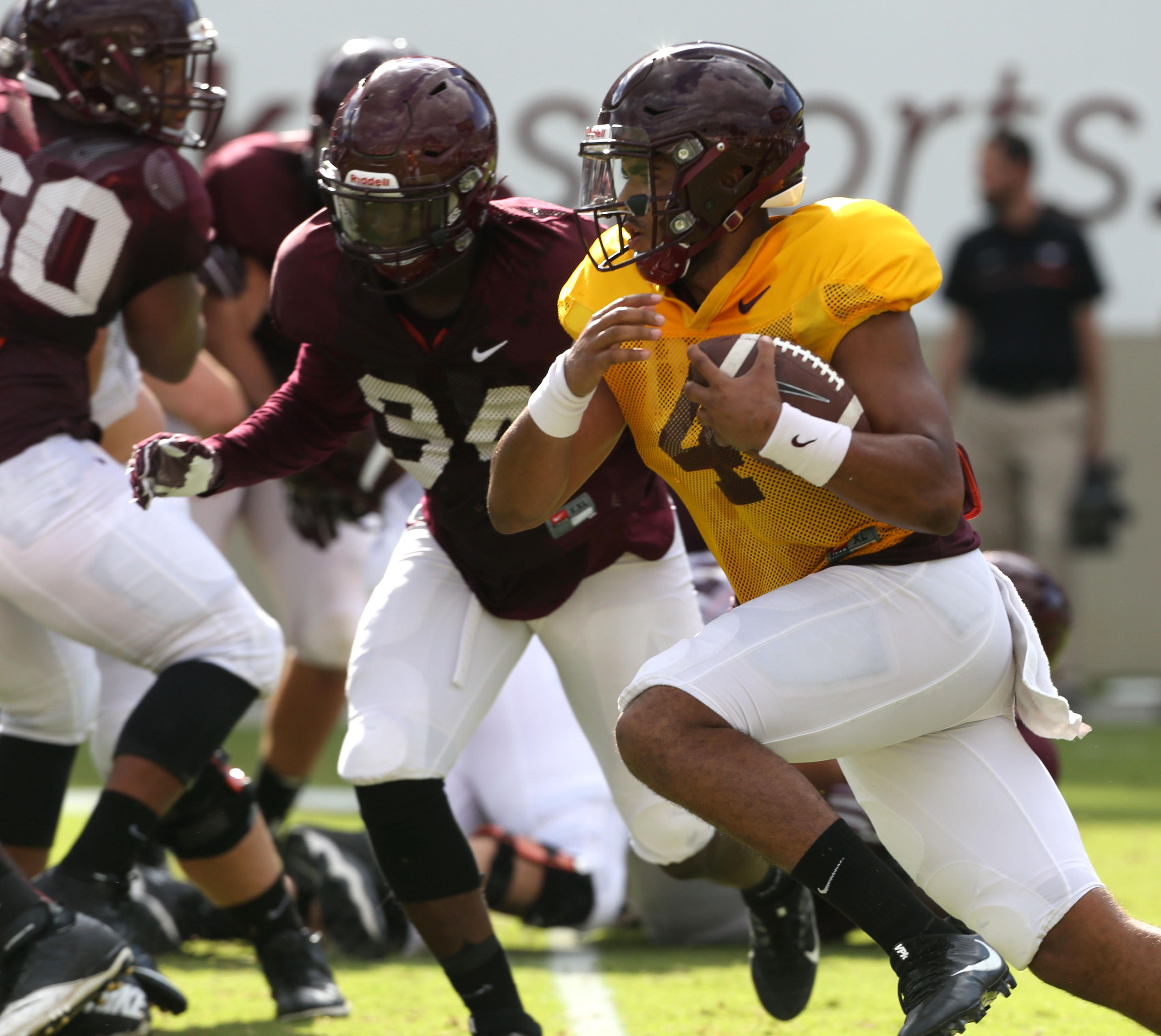 Virginia Tech quarterback Jerod Evans (4) runs the ball during the NCAA college football team's practice Tuesday, Aug. 23, 2016, in Blacksburg, Va. (Matt Gentry/The Roanoke Times via AP)
