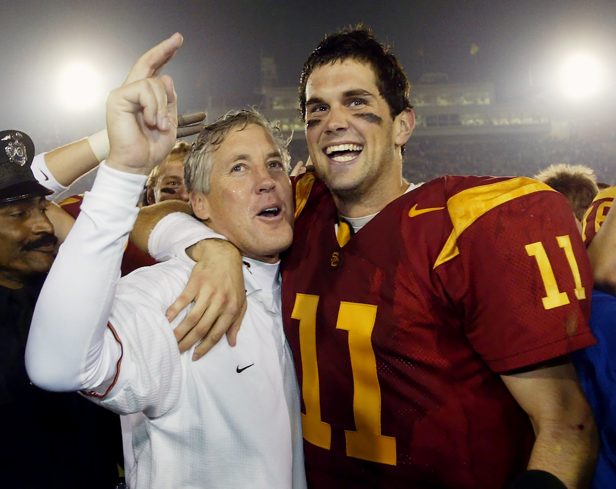 FILE - In this Dec. 6, 2003, file photo, Southern California quarterback Matt Leinart, right, hugs head coach Pete Carroll as they celebrate their win over Orgeon State, 52-28, in Los Angeles. In the 80-year history of The Associated Press college footbal