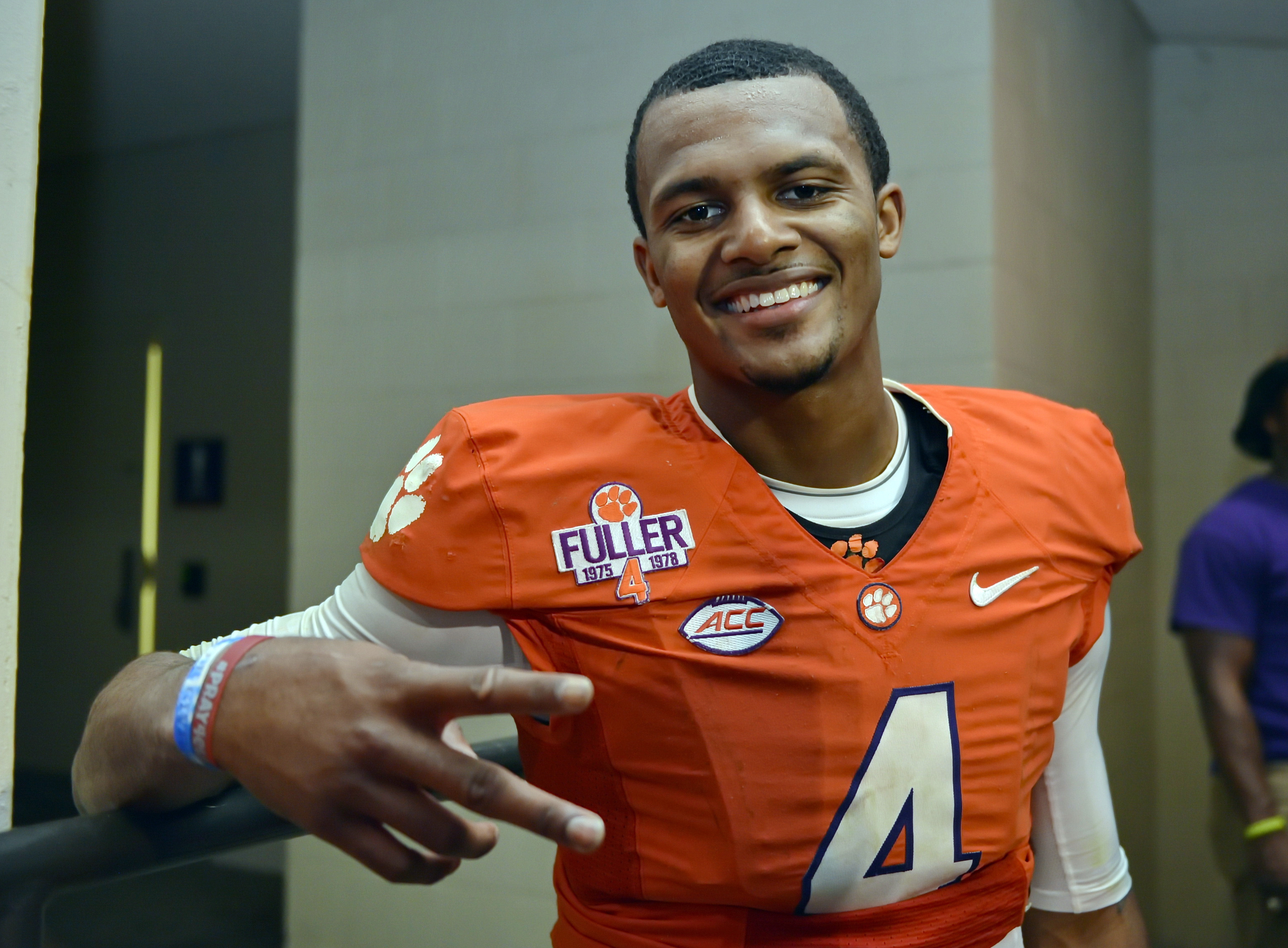 FILE - In this Nov. 7, 2015, file photo, Clemson quarterback Deshaun Watson poses for a photo after their 23-17 win over Florida State in an NCAA college football game, in Clemson, S.C. Watson says he's ready for the onslaught and plans to handle the glar
