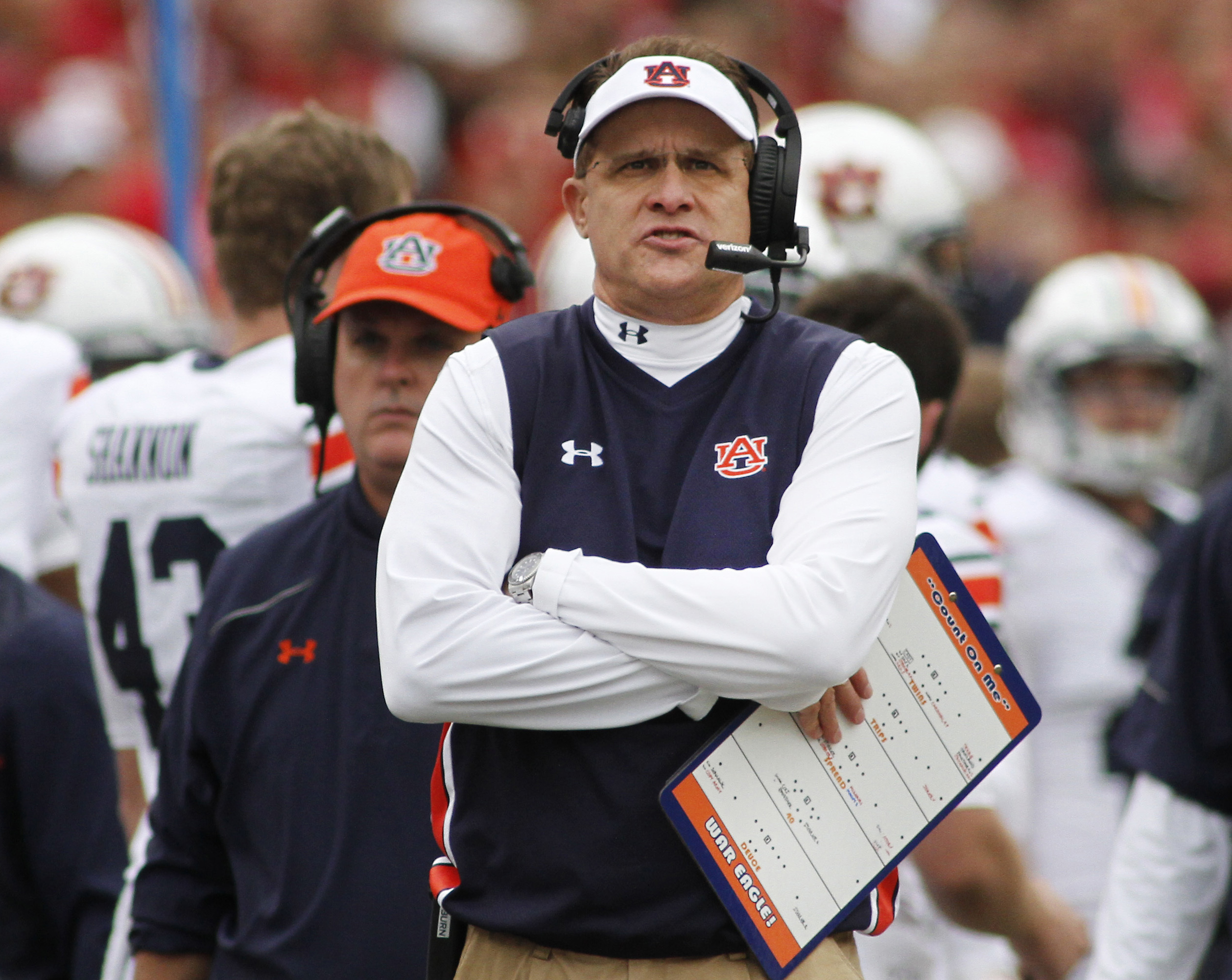 FILE - In this Oct. 24, 2015, file photo, Auburn coach Gus Malzahn looks to the scoreboard during an NCAA college football game against Arkansas in Fayetteville, Ark. (AP Photo/Samantha Baker, File)