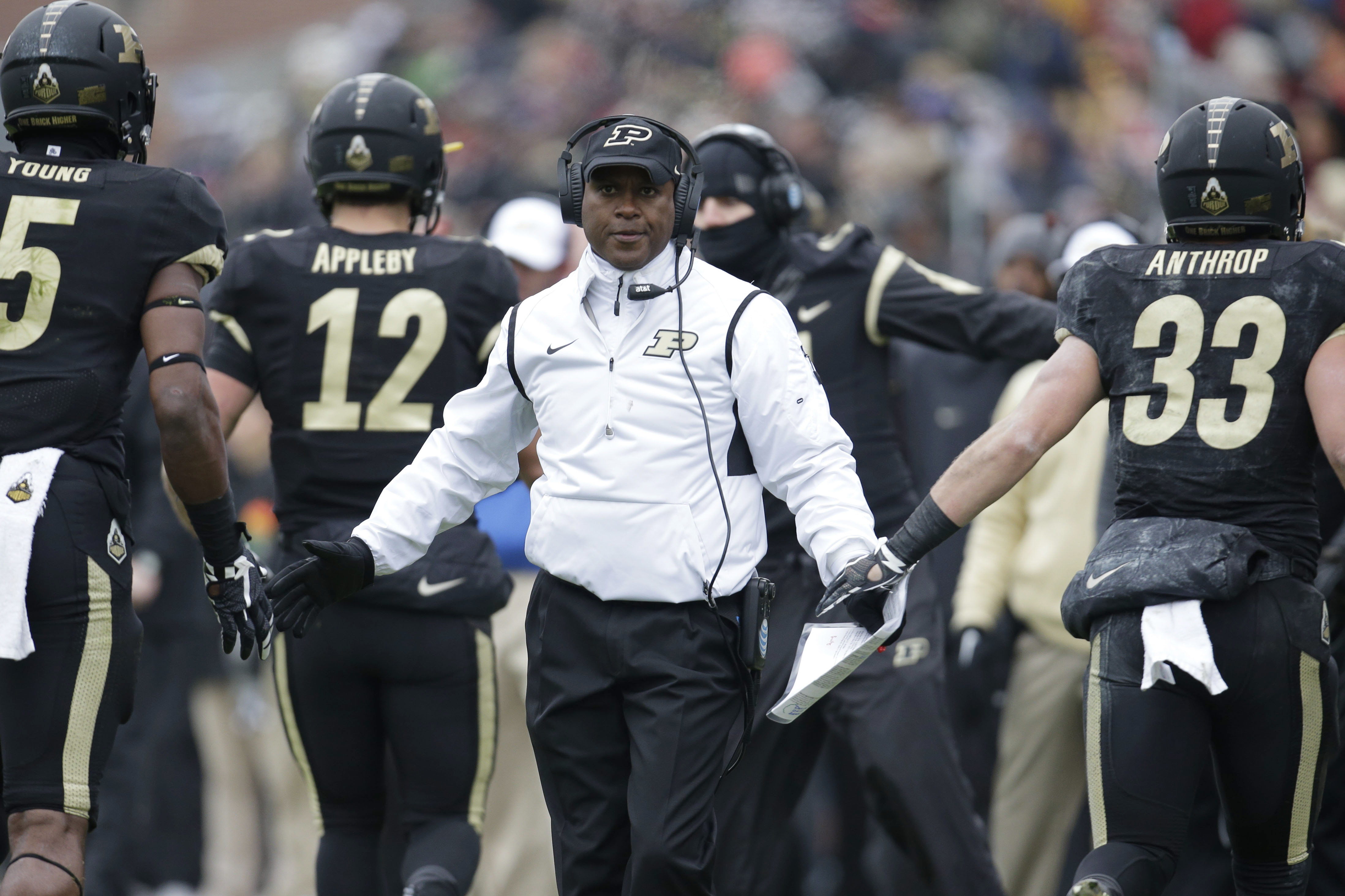 FILE - In this Nov. 28, 2015, file photo, Purdue coach Darrell Hazell congratulates his players after a score against Indiana during an NCAA college football game in West Lafayette, Ind. Hazell is 6-30 in three seasons with Purdue. (AP Photo/AJ Mast, File