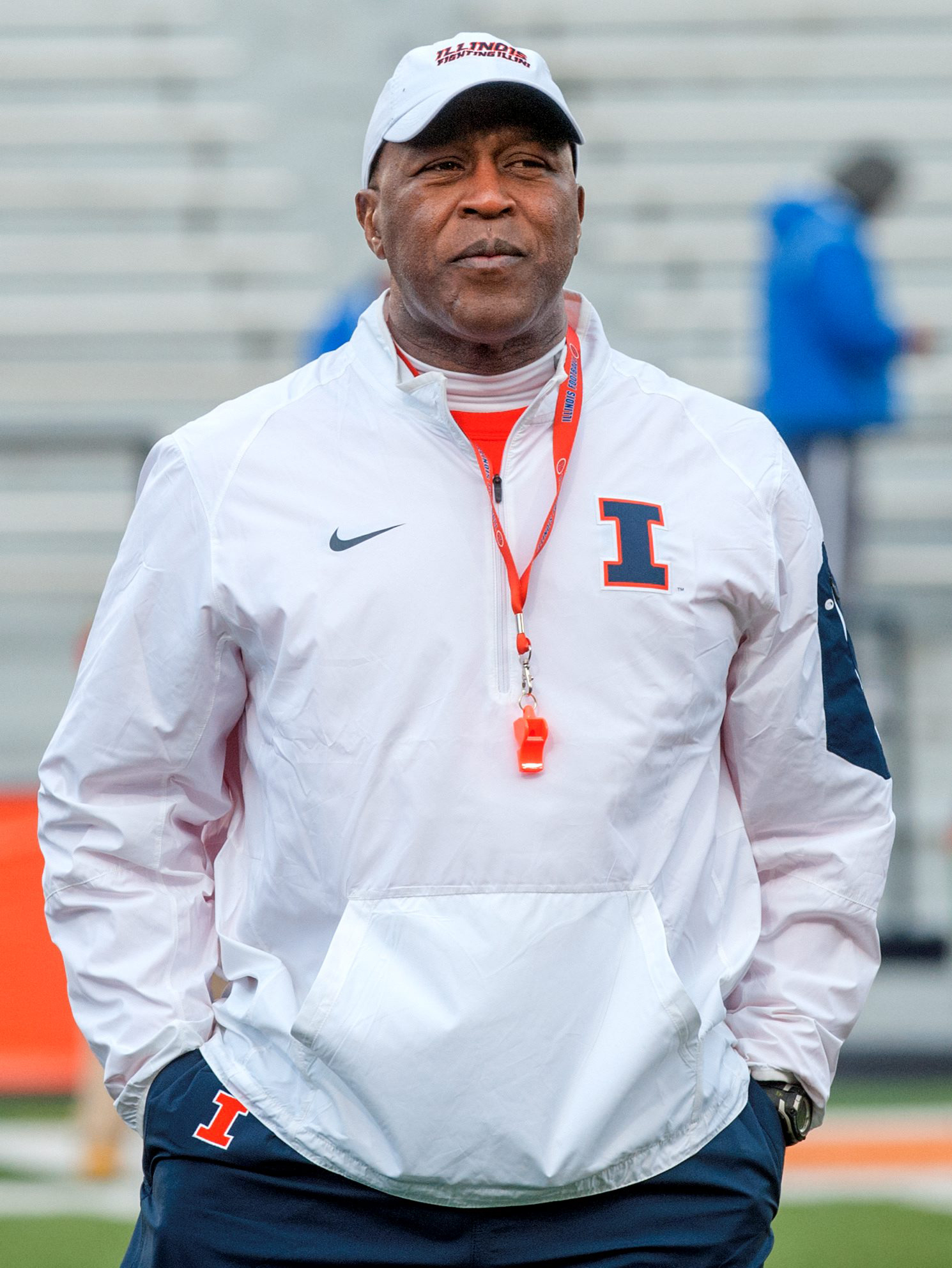 In this April 1, 2016, photo, first-year Illinois football coach Lovie Smith oversees his team's practice at Memorial Stadium in Champaign, Ill. Smith brings decades of NFL experience that both fans and players see as an upgrade and potential starting poi