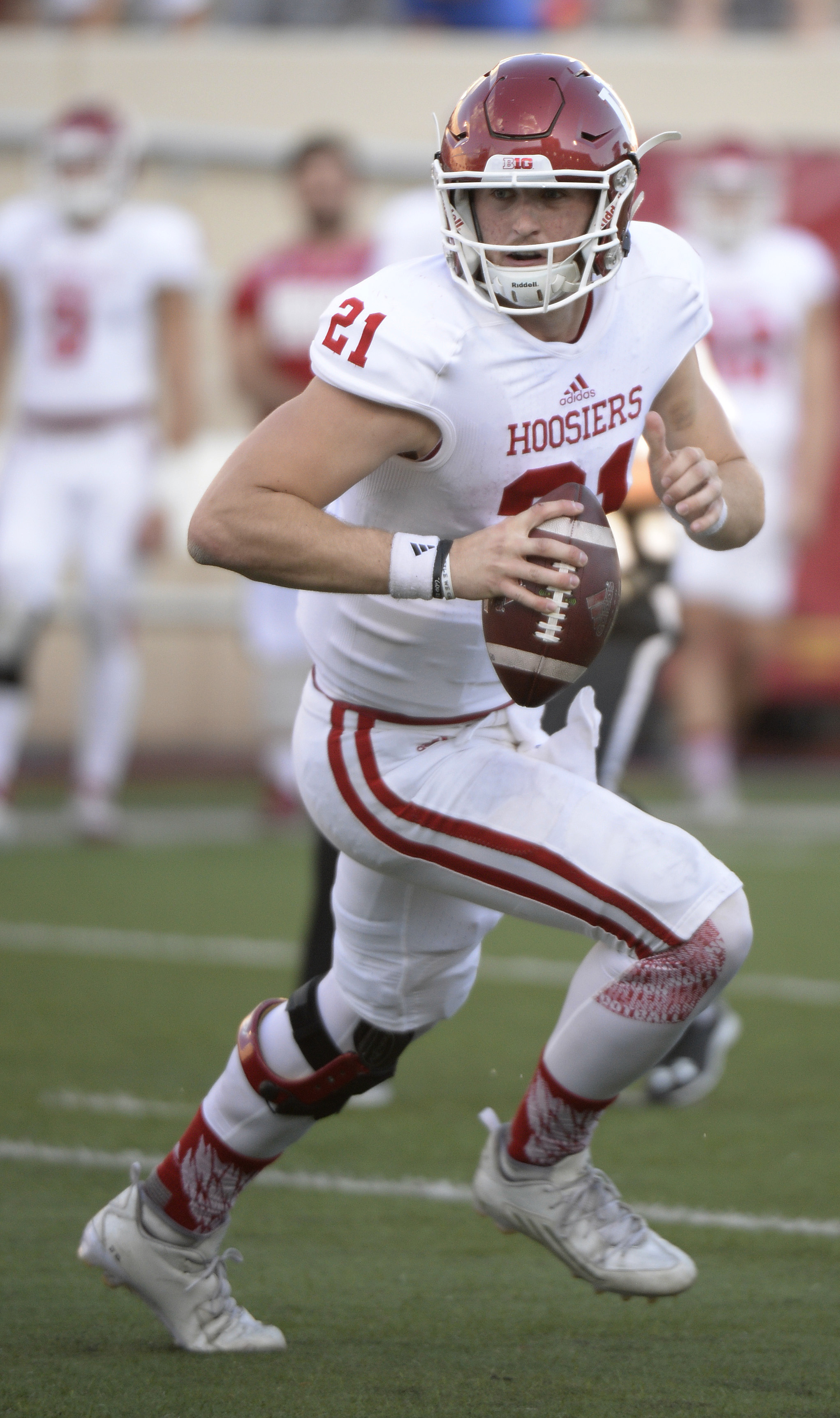 FILE - In this April 15, 2016, file photo, Indiana quarterback Richard Lagow (21) rolls out during the Cream and Crimson spring football game at Memorial Stadium in Bloomington, Ind. Lagow will start Thursday night at Florida International. Coach Kevin Wi