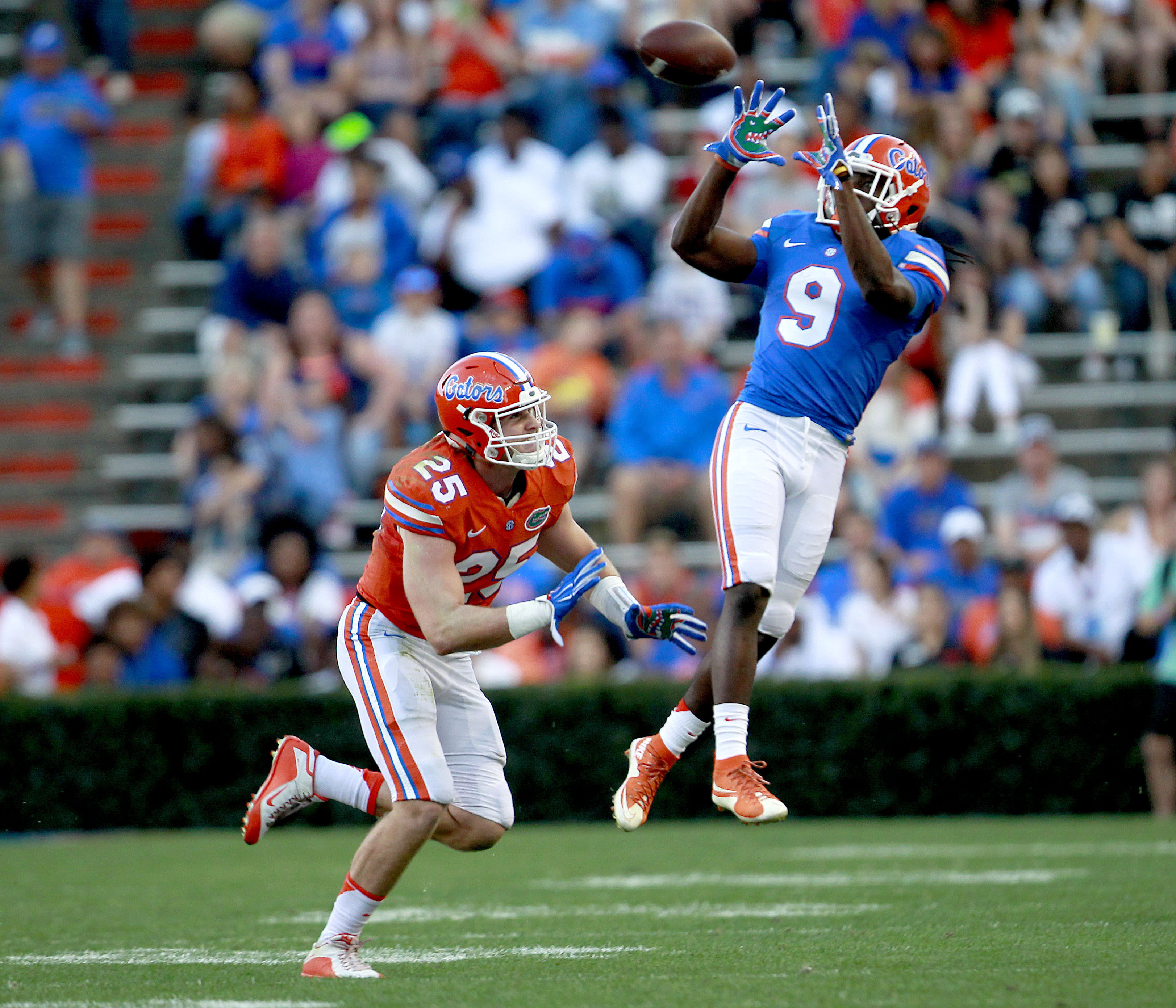 In this April 8, 2016, file photo, Florida receiver Dre Massey jumps to make a catch in front of Florida linebacker Matt Rolin during a spring football game in Gainesville, Fla. Massey is Florida's most versatile player, capable of lining up at receiver,