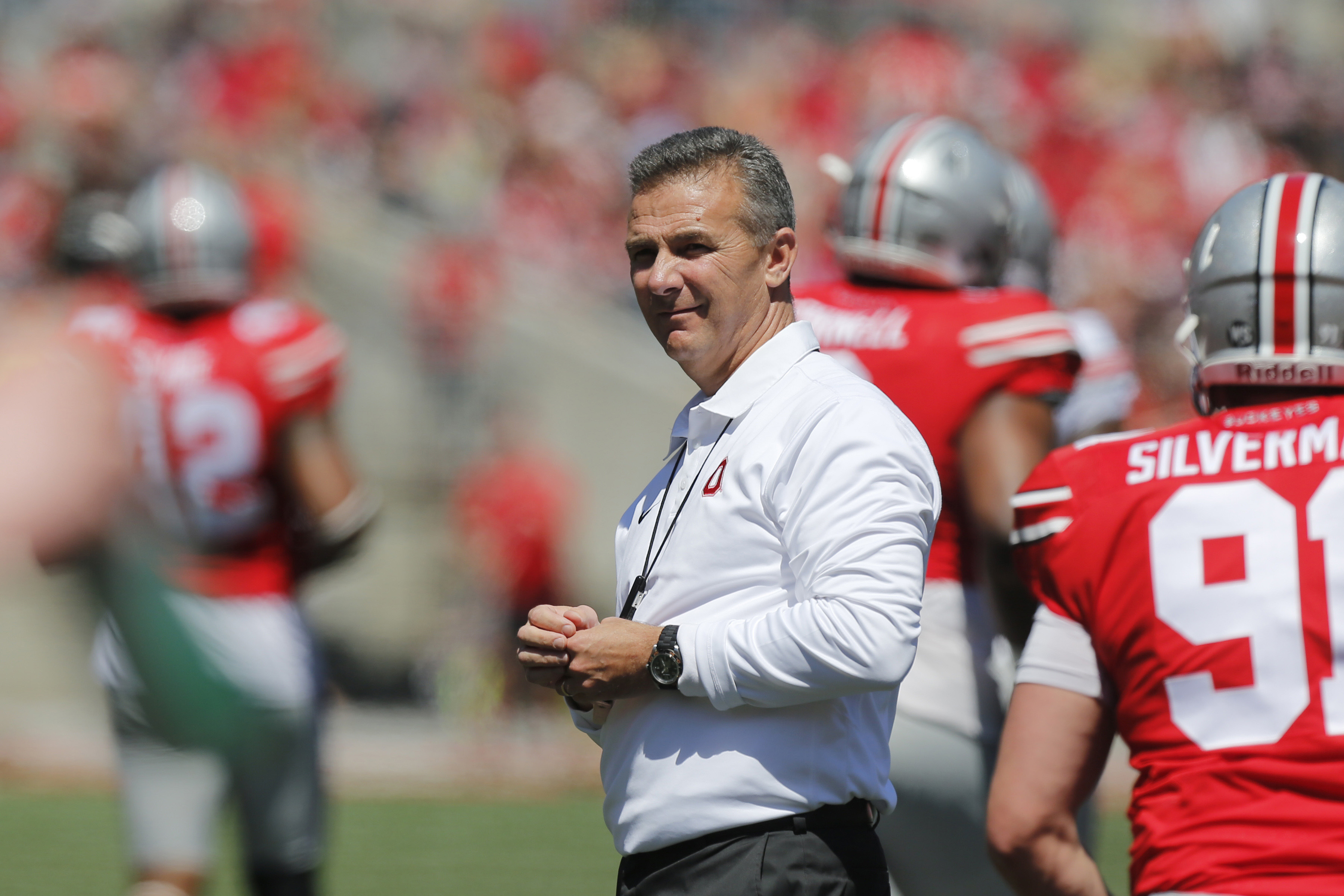 "FILE - In this April 16, 2016, file photo, Ohio State head coach Urban Meyer watches the team's NCAA college football spring game in Columbus, Ohio. ""The Edge,"" this season's motivational mantra for Ohio State football, is among the messages the program i"