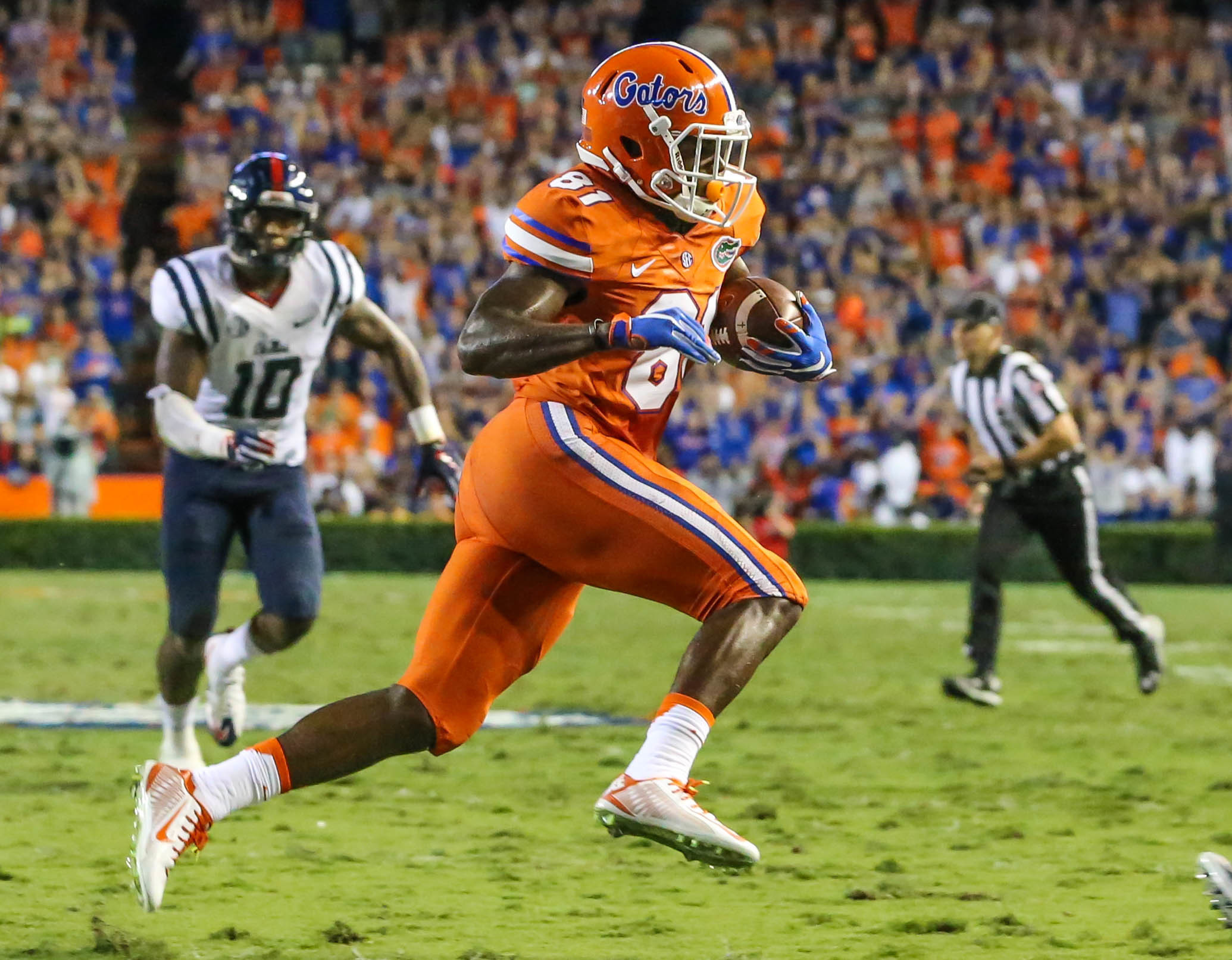 FILE - In this Oct. 3, 2015, file photo, Florida wide receiver Antonio Callaway (81) runs the ball in for a touchdown after making a catch against Mississippi during the first half of an NCAA college football game in Gainesville, Fla.  Callaway, suspended