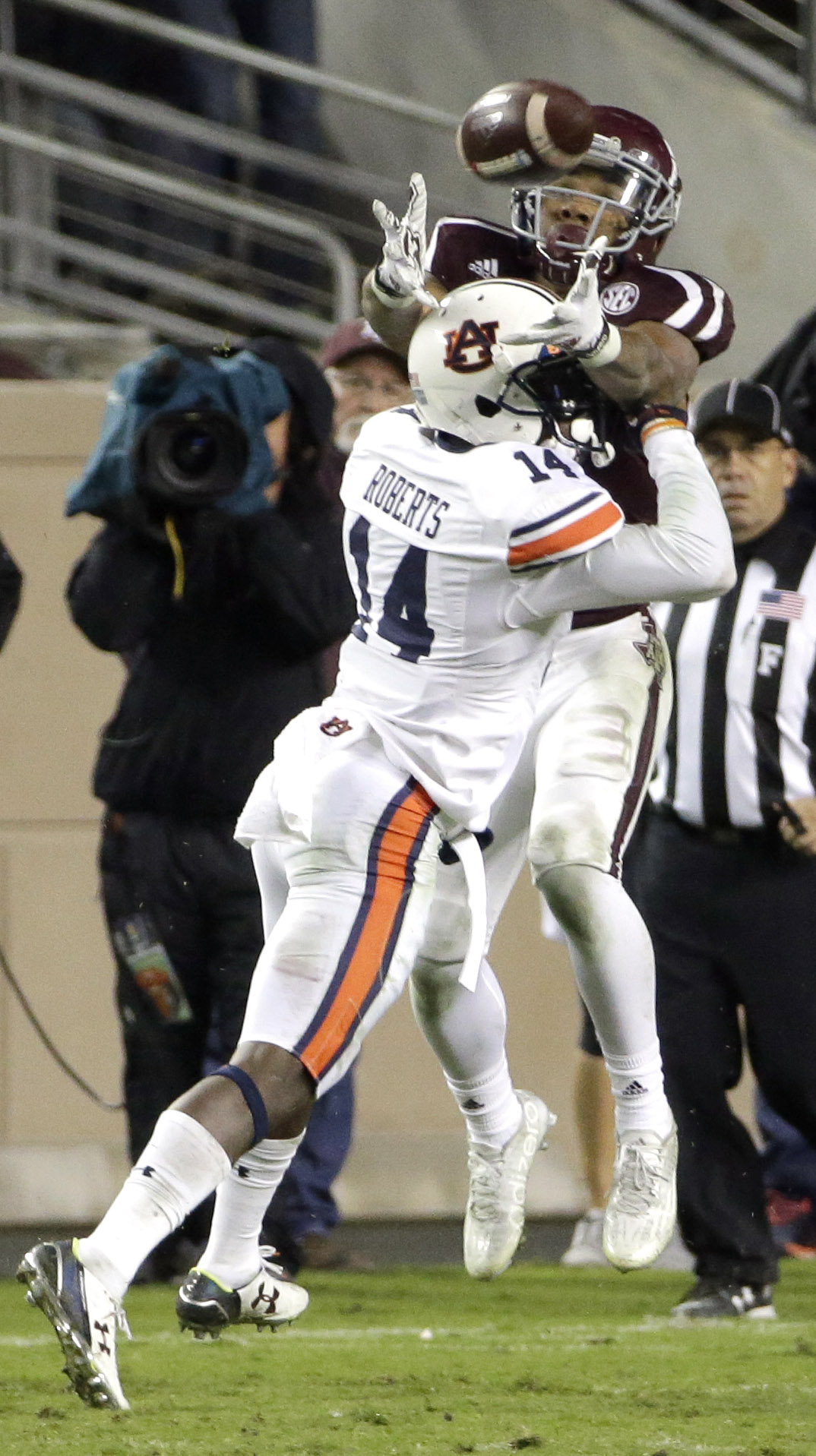 Auburn defensive back Stephen Roberts (14) breaks up a pass intended for Texas A&M wide receiver Christian Kirk during the second half of an NCAA college football game Saturday, Nov. 7, 2015, in College Station, Texas. Roberts was called for pass interfer