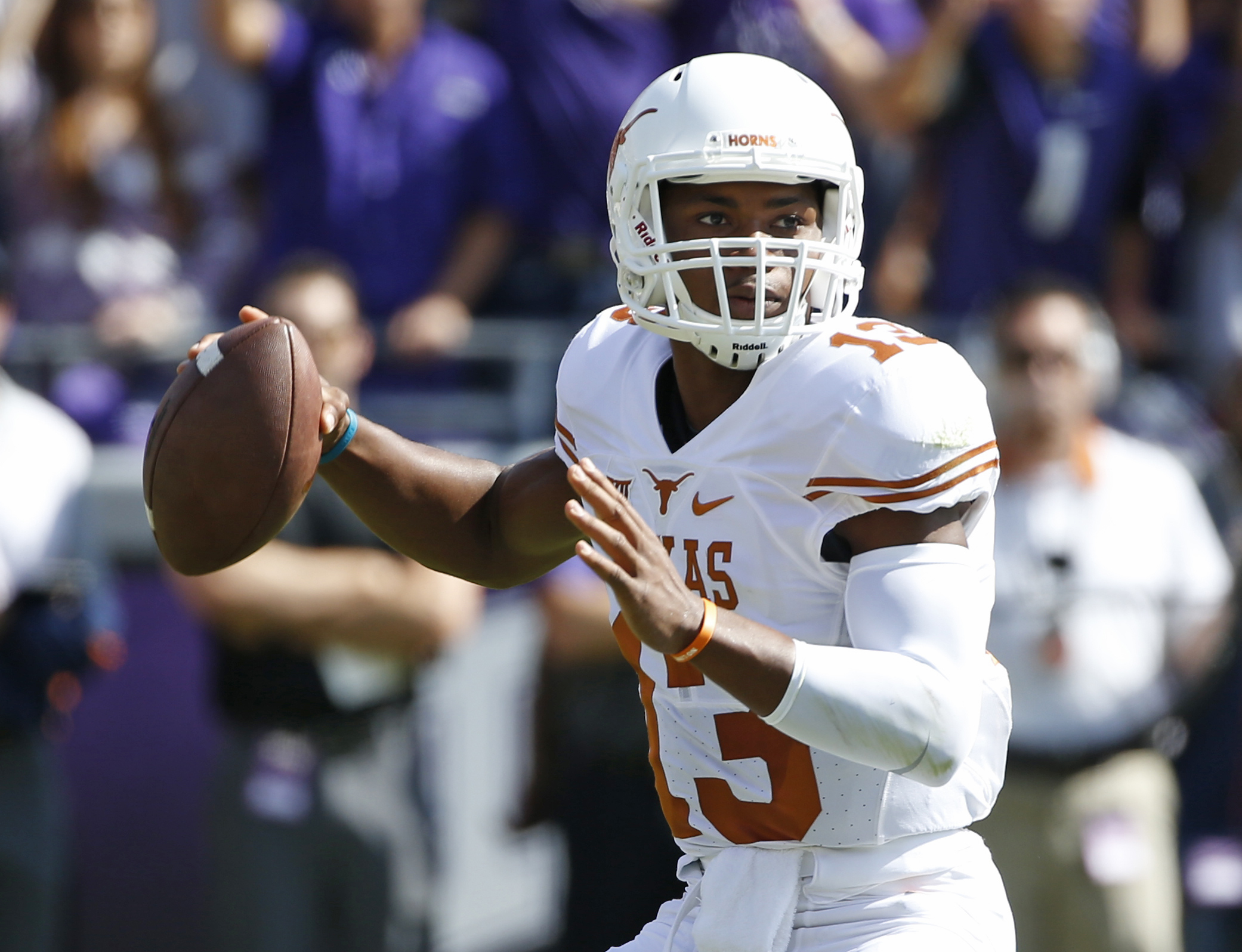 FILE - In this Oct. 3, 2015, file photo, Texas quarterback Jerrod Heard (13) looks to throw in the first quarter against TCU in an NCAA college football game, in Fort Worth, Texas. The Texas quarterback competition dominating Longhorns training camp has l