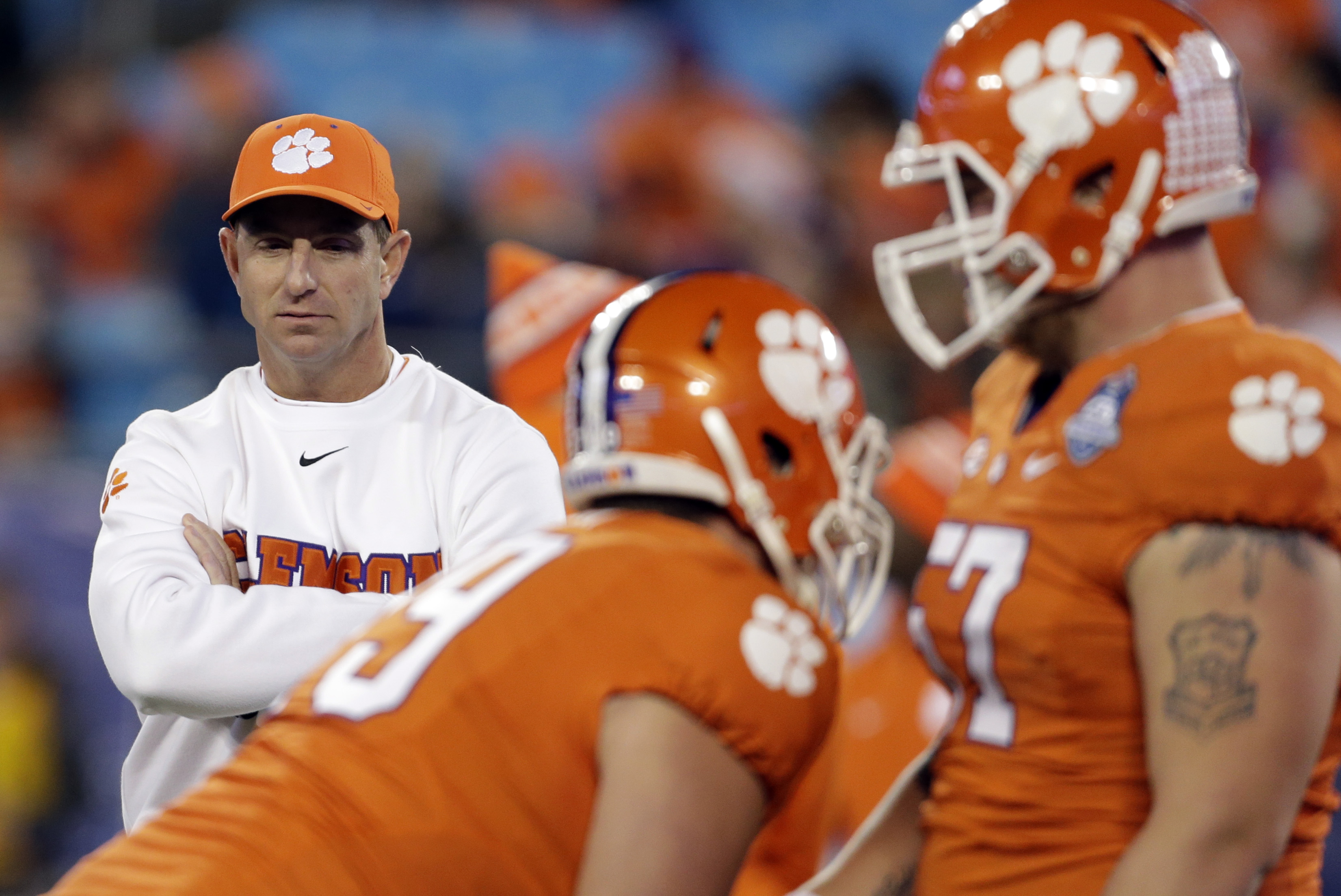 FILE - In this Dec. 5, 2015, file phot, Clemson head coach Dabo Swinney watches prior to the Atlantic Coast Conference championship NCAA college football game against North Carolina in Charlotte, N.C. Three SEC-ACC matchups and Pittsburgh RB James Conners