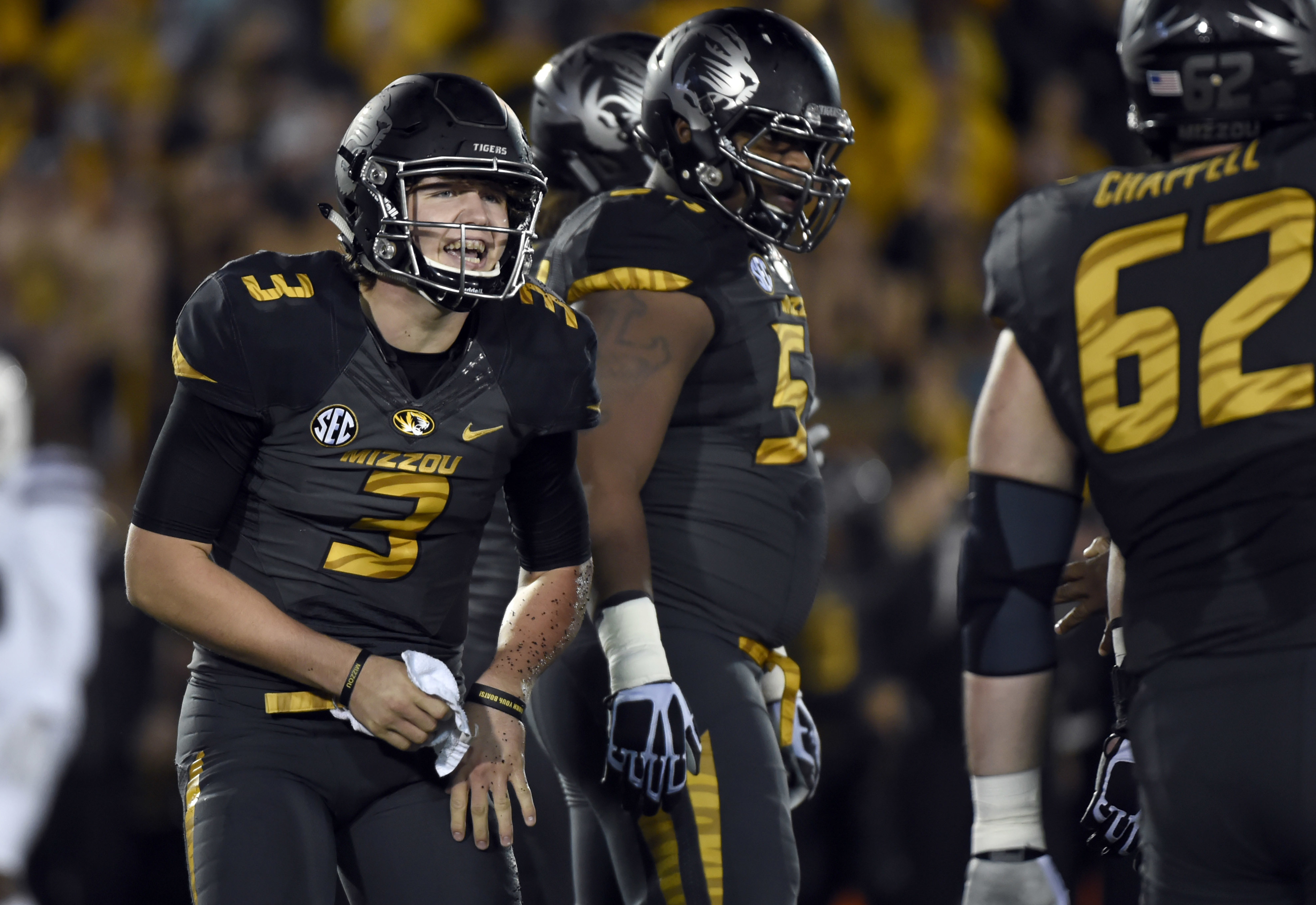 FILE - In this Nov. 5, 2015, file photo, Missouri quarterback Drew Lock left, and teammates get ready to run a play during an NCAA college football game against Mississippi State in Columbia, Mo. Though only a sophomore, Lock has more experience than the