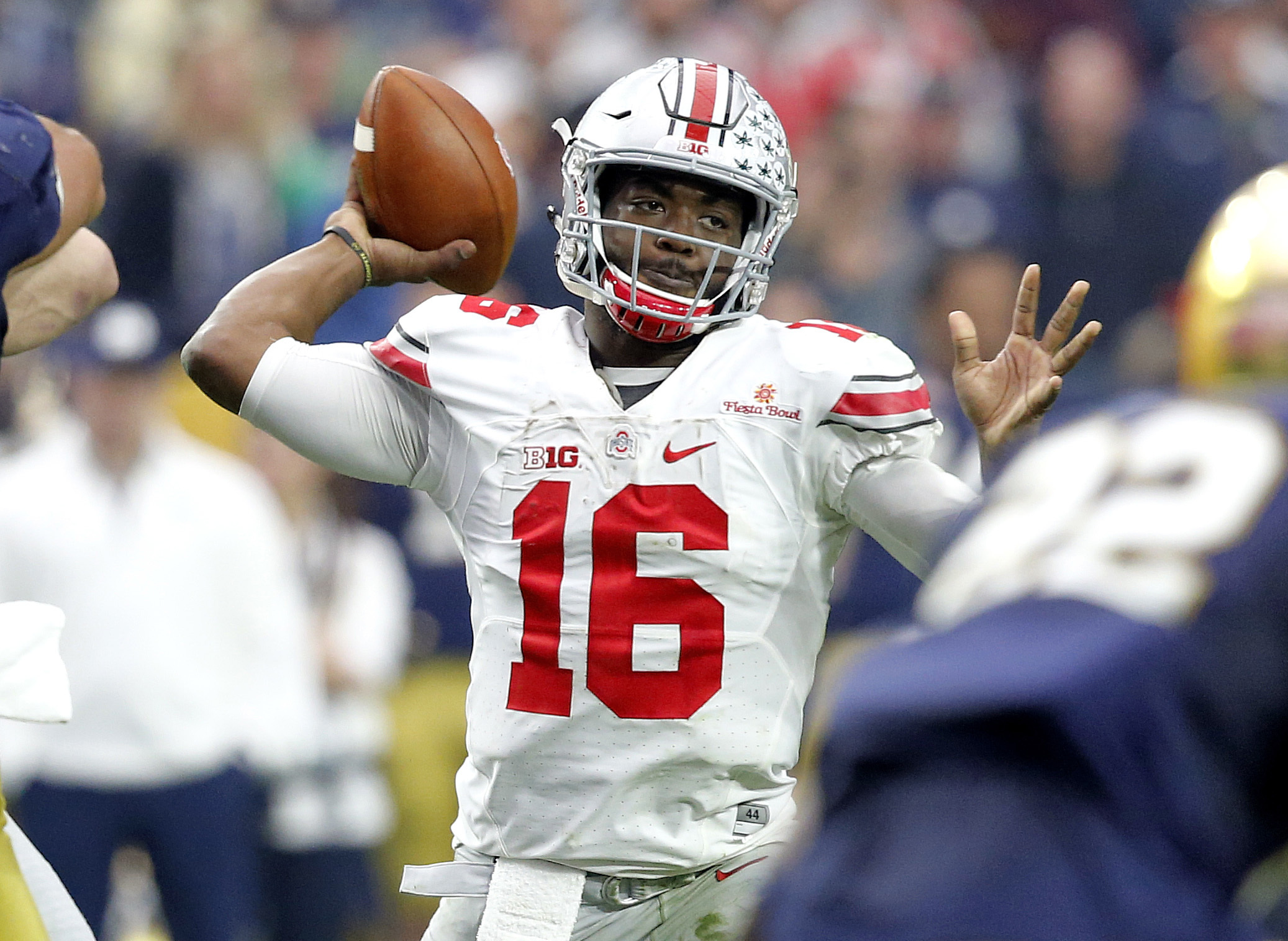 FILE - In this Jan. 1, 2016, file photo, Ohio State quarterback J.T. Barrett (16) throws a pass against Notre Dame during the second half of the Fiesta Bowl NCAA College football game in Glendale, Ariz. Last year Ohio States offensive engine was powered m