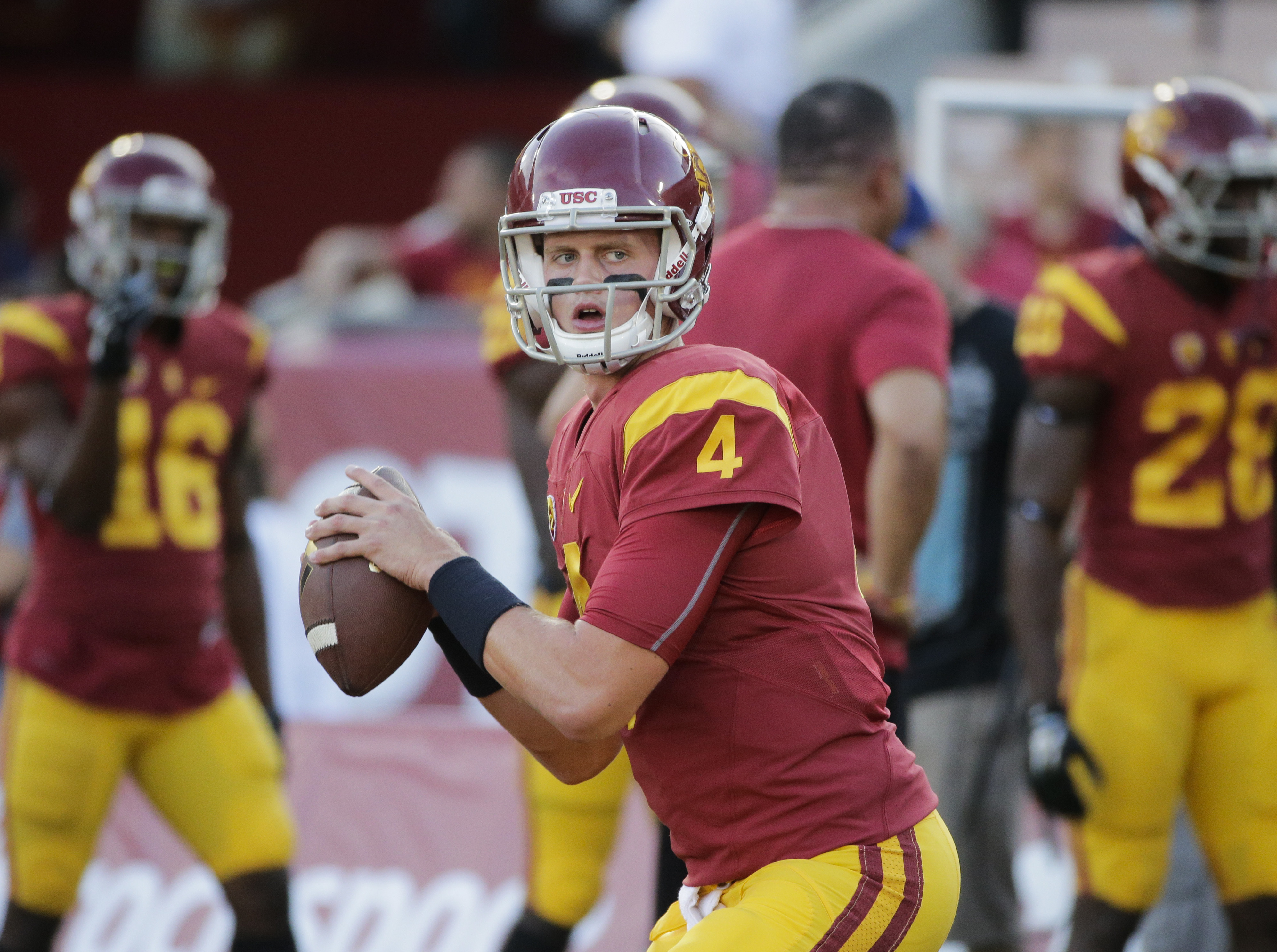 FILE - In this Oct. 8, 2015, file photo, Southern California quarterback Max Browne warms up before an NCAA college football game against Washington, in Los Angeles. Max Browne insists he wouldn't want slightly less daunting circumstances for his long-awa