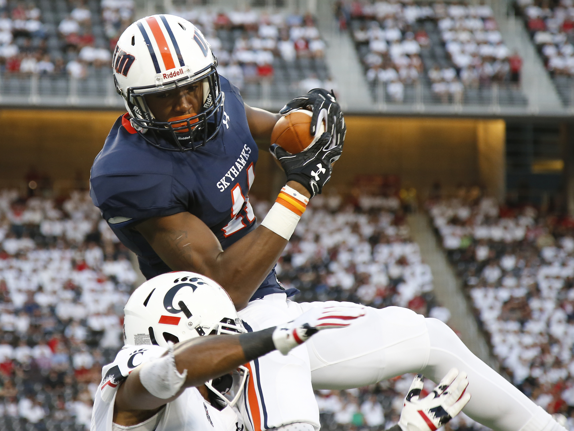 Tennessee-Martin wide receiver Kyle Kerrick (17) leaps to make a catch along the sideline  during the first half of an NCAA college football game against Cincinnati, Thursday, Sept. 1, 2016, at Nippert Stadium in Cincinnati. (Kareem Elgazzar/The Cincinnat