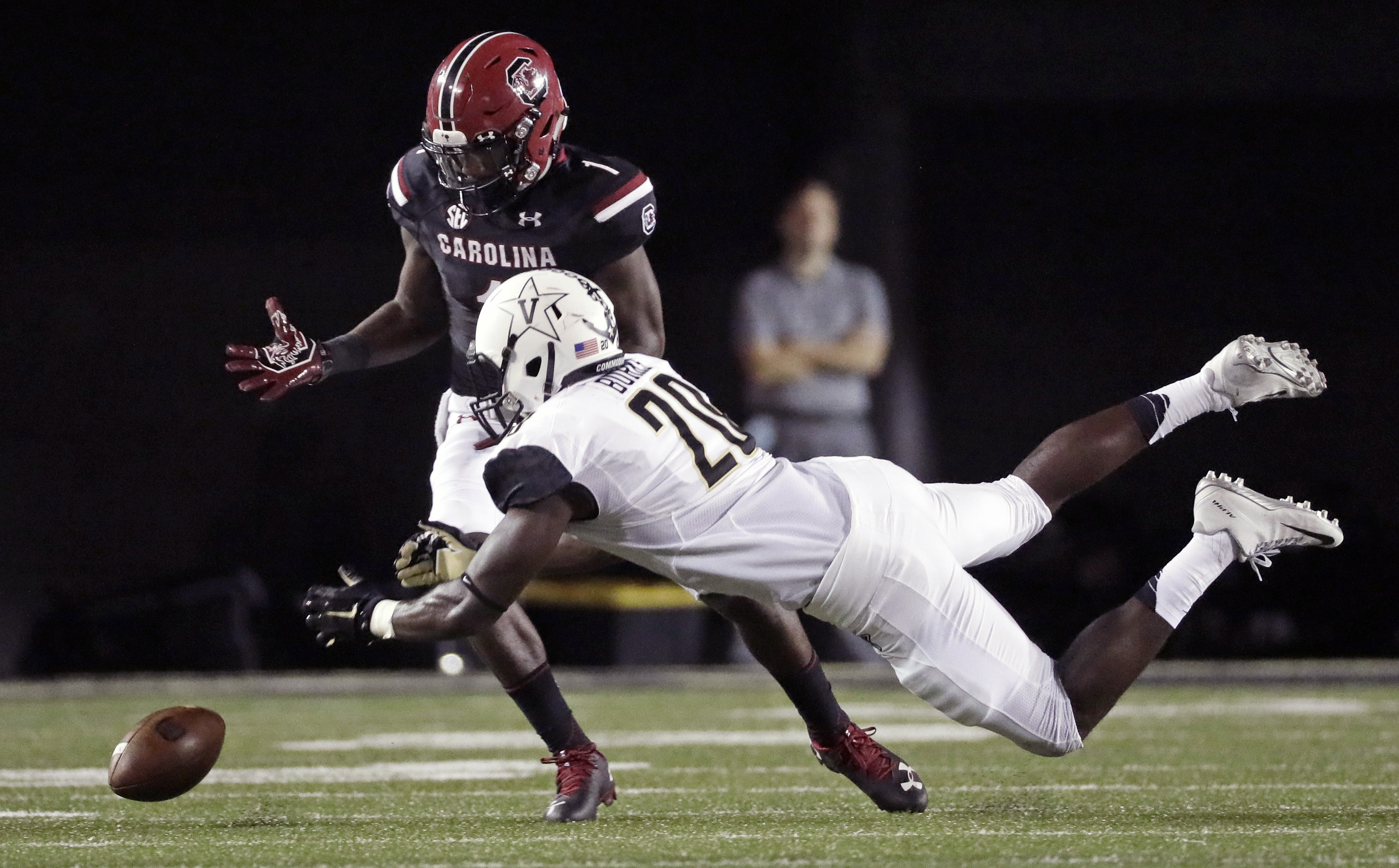 Vanderbilt linebacker Oren Burks (20) breaks up a pass intended for South Carolina wide receiver Deebo Samuel in the first half of an NCAA college football game Thursday, Sept. 1, 2016, in Nashville, Tenn. (AP Photo/Mark Humphrey)