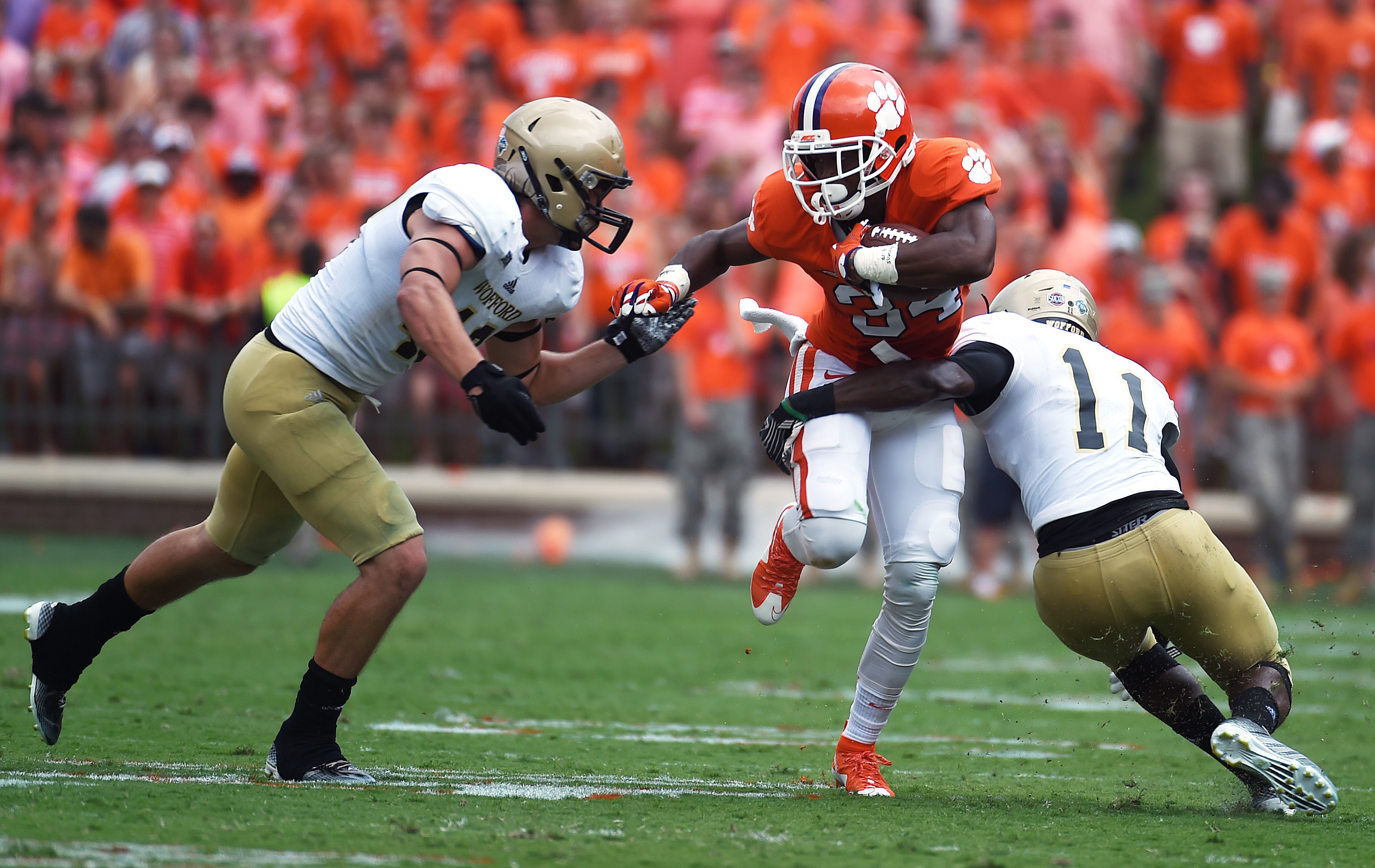 FILE - In this Sept. 5, 2015, file photo, Clemson wide receiver Ray Ray McCloud (34) runs after a catch as Wofford safety Jaleel Green (11) and linebacker Michael Roach (43) defend during the first half of an NCAA college football game in Clemson, S.C. Ro