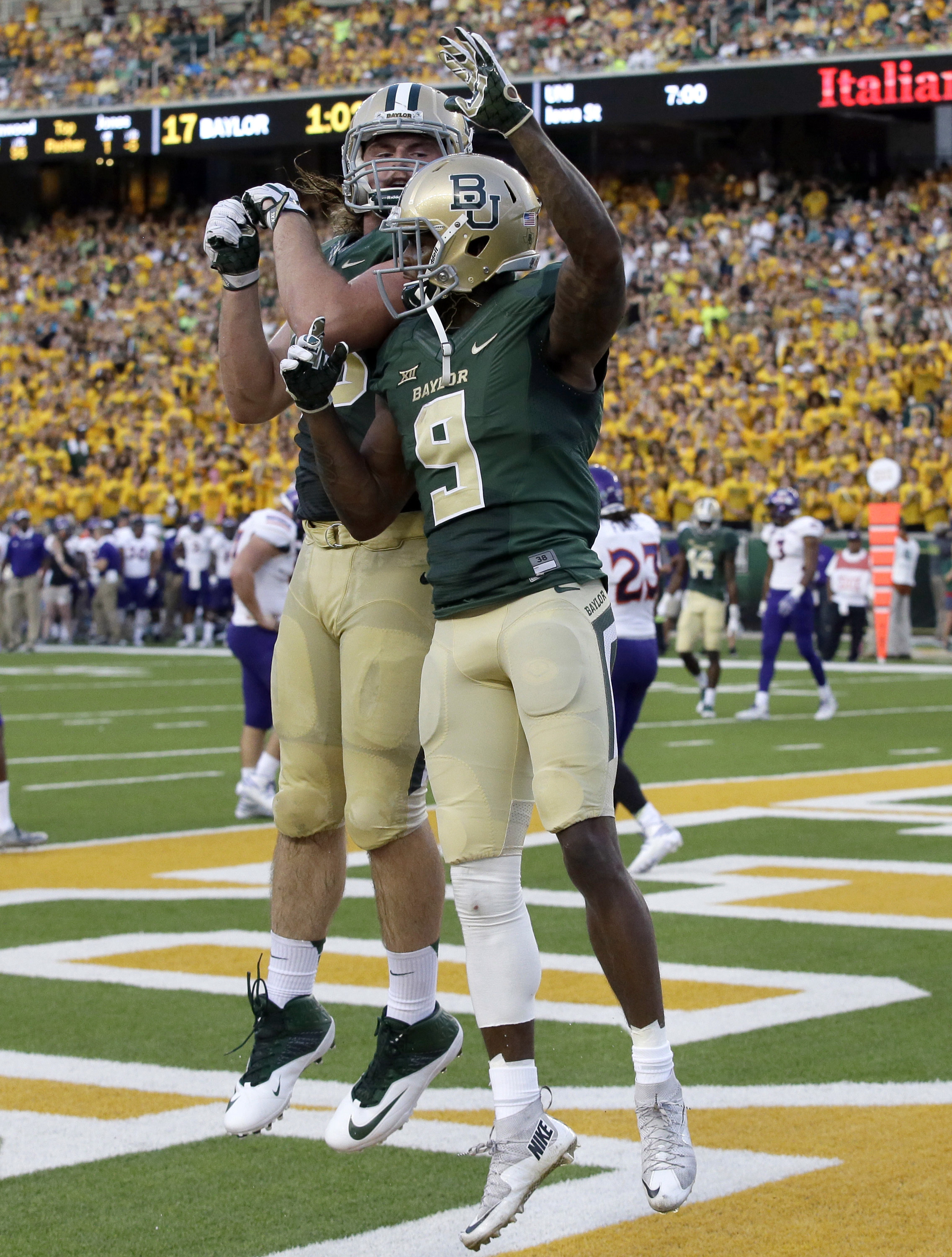 Baylor wide receiver KD Cannon (9) celebrates with teammate Sam Tecklenburg after catching a touchdown pass during the first half of an NCAA college football game Friday, Sept. 2, 2016, in Waco, Texas. (AP Photo/LM Otero)