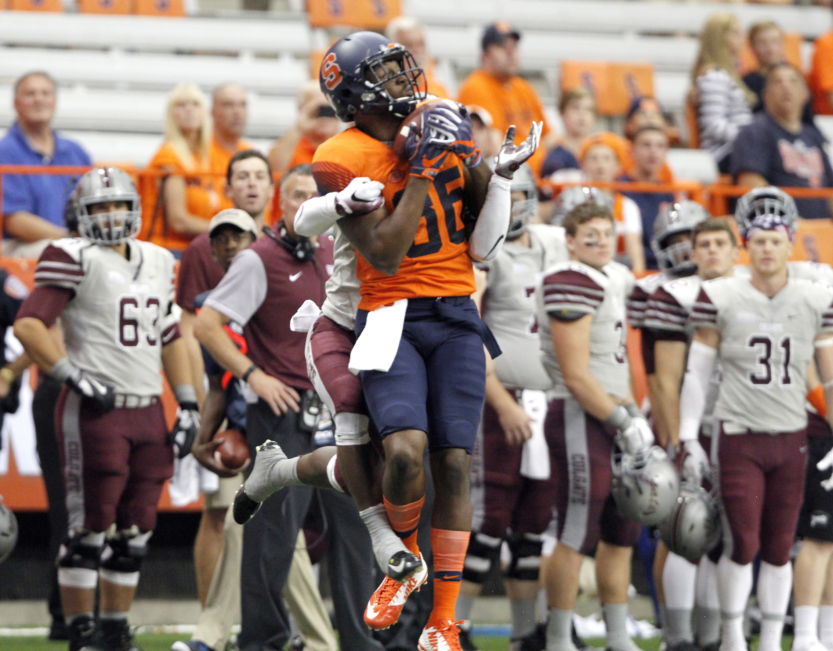 Syracuse's Adly Enoicy makes the catch while guarded by Colgate's Abu Daramy in the second half of an NCAA college football game in Syracuse, N.Y., Friday, Sept. 2, 2016. (AP Photo/Nick Lisi)