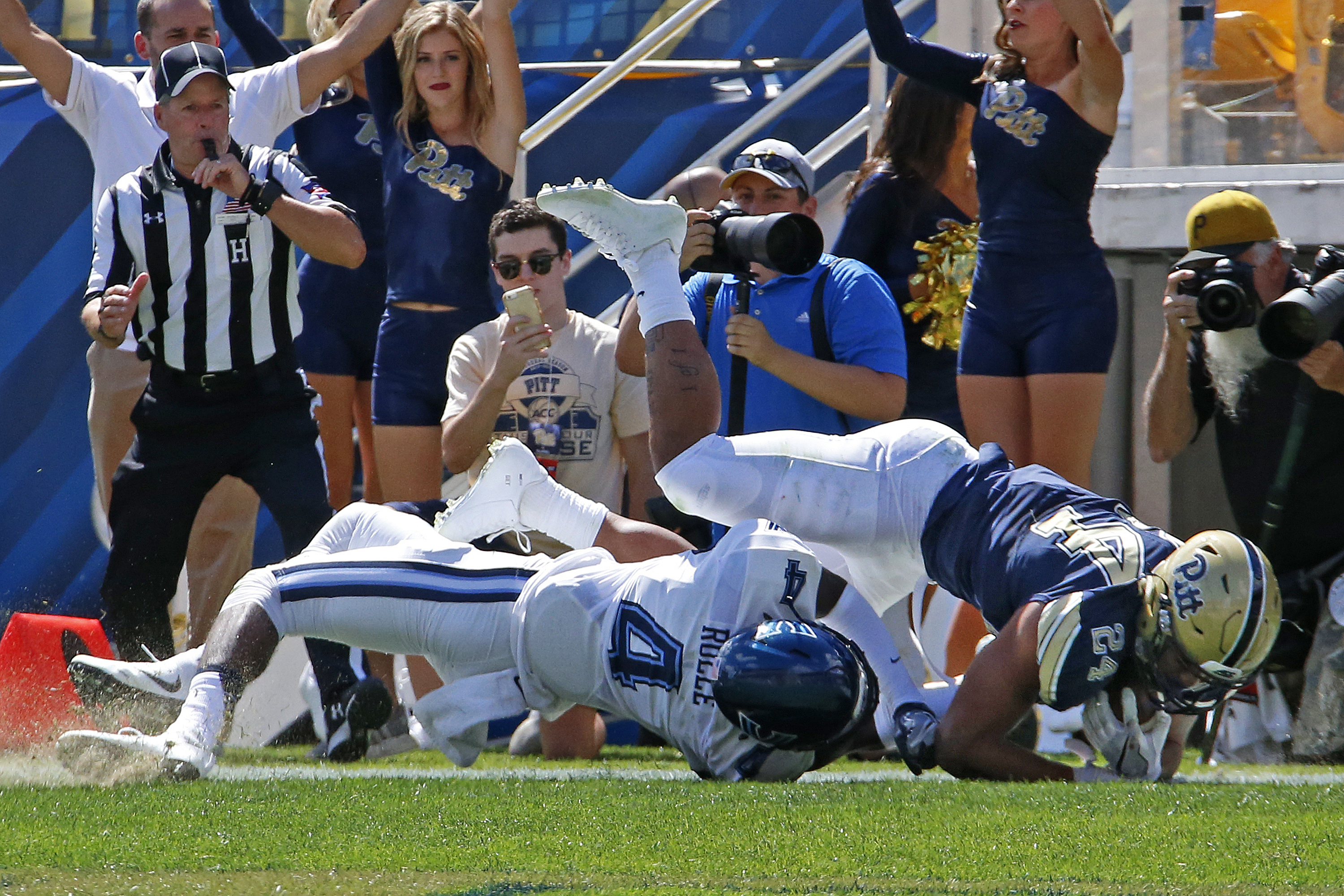 Pittsburgh running back James Conner (24) scores on a 3-yard run over Villanova's Rob Rolle (4) during the first half of an NCAA college football game in Pittsburgh, Saturday, Sept. 3, 2016. (AP Photo/Gene J. Puskar)