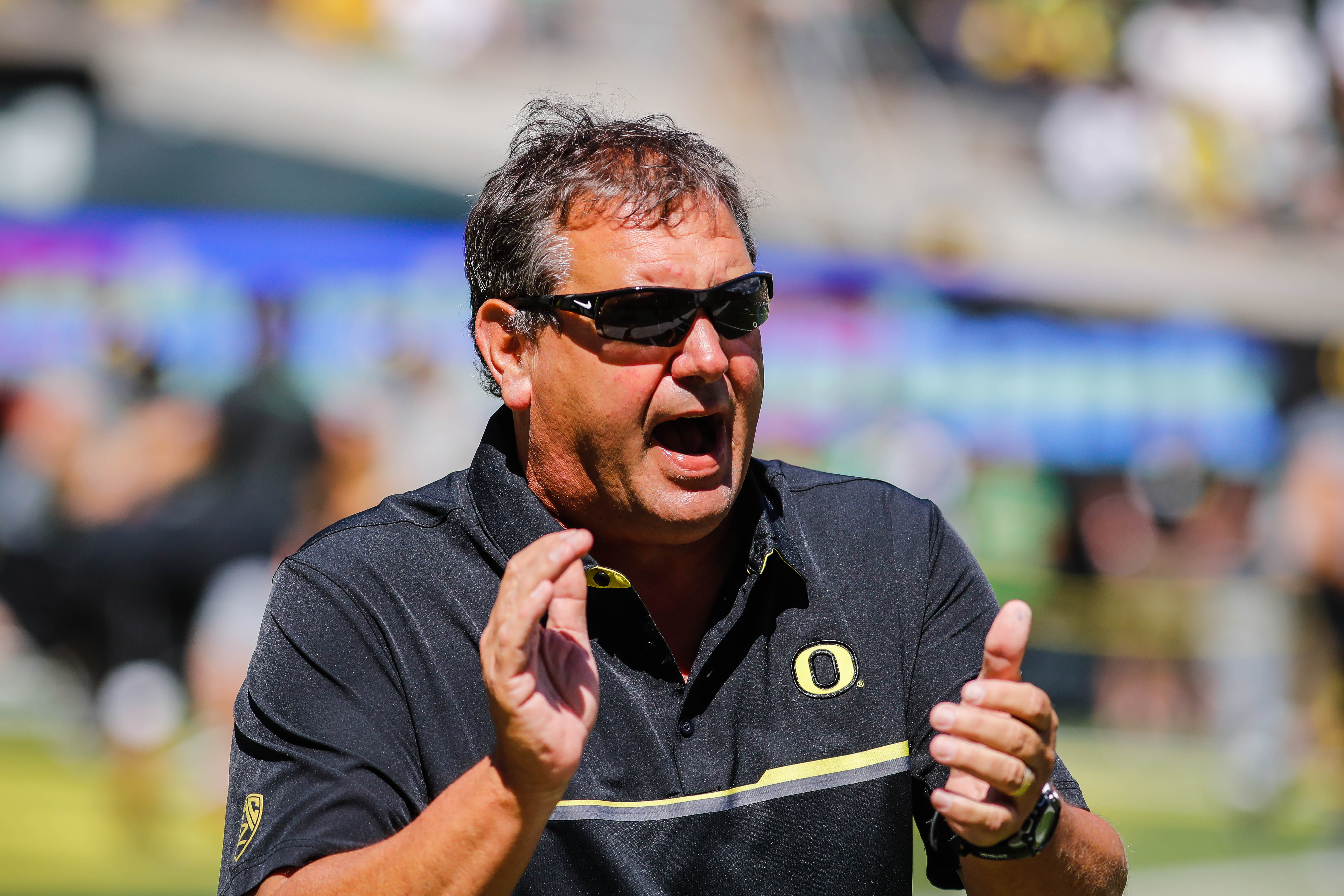 Oregon defensive coordinator Brady Hoke warms up the defensive linemen before playing UC Davis during an NCAA college football game in Eugene, Ore., Saturday, Sept. 3, 2016. (AP Photo/Thomas Boyd)