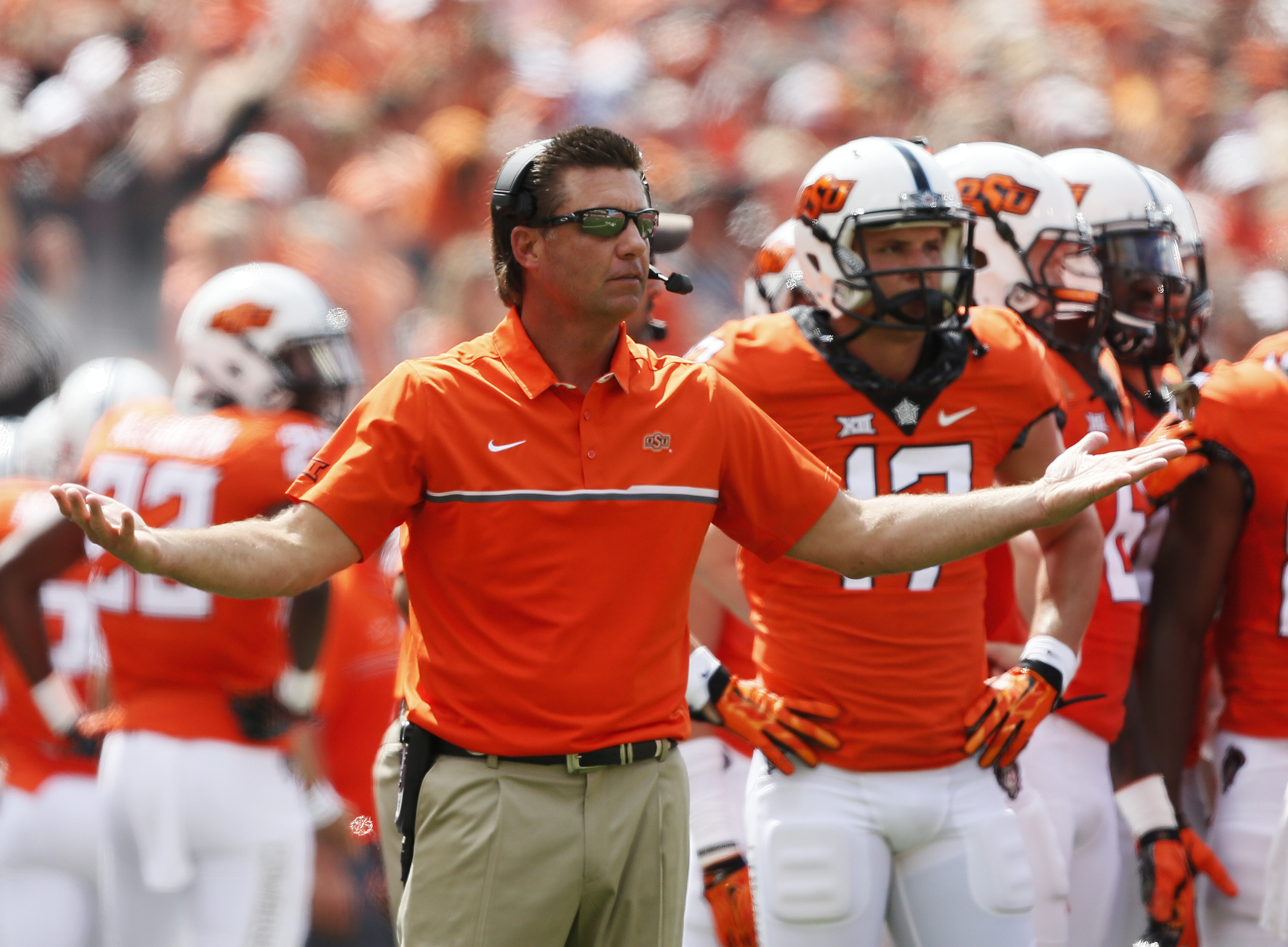 Oklahoma State head coach Mike Gundy gestures to an official in the first half of an NCAA college football game against Southeastern Louisiana in Stillwater, Okla., Saturday, Sept. 3, 2016. (AP Photo/Sue Ogrocki)