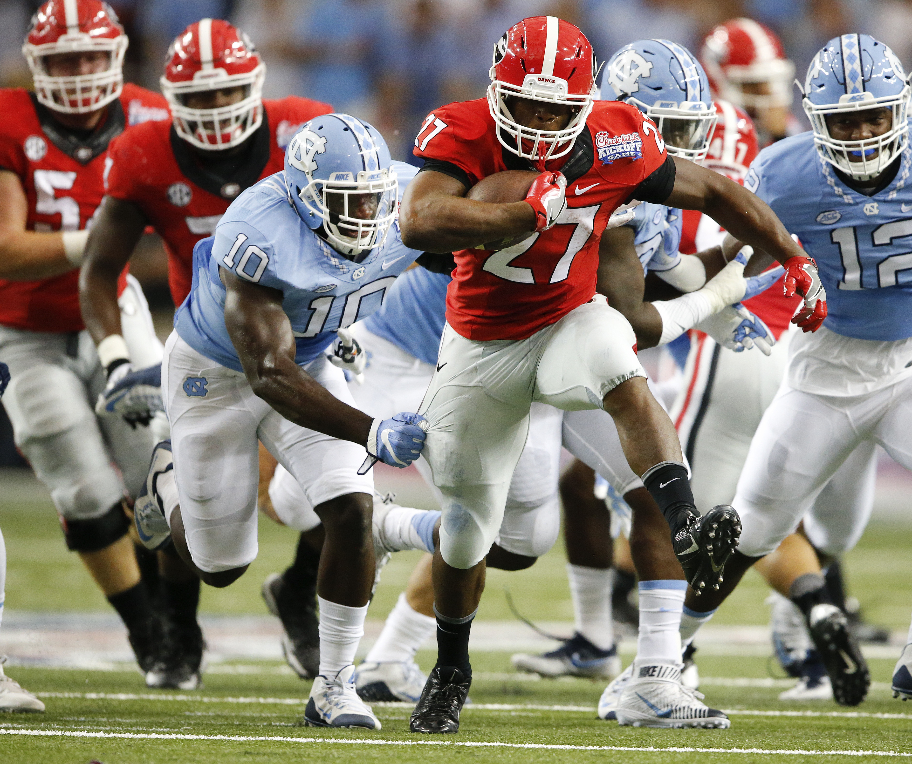 Georgia running back Nick Chubb (27) tries to breaks away from North Carolina linebacker Andre Smith (10) in the first of an NCAA college football game against North Carolina in Atlanta, Saturday, Sept. 3, 2016. Chubb missed most of last season with a kne