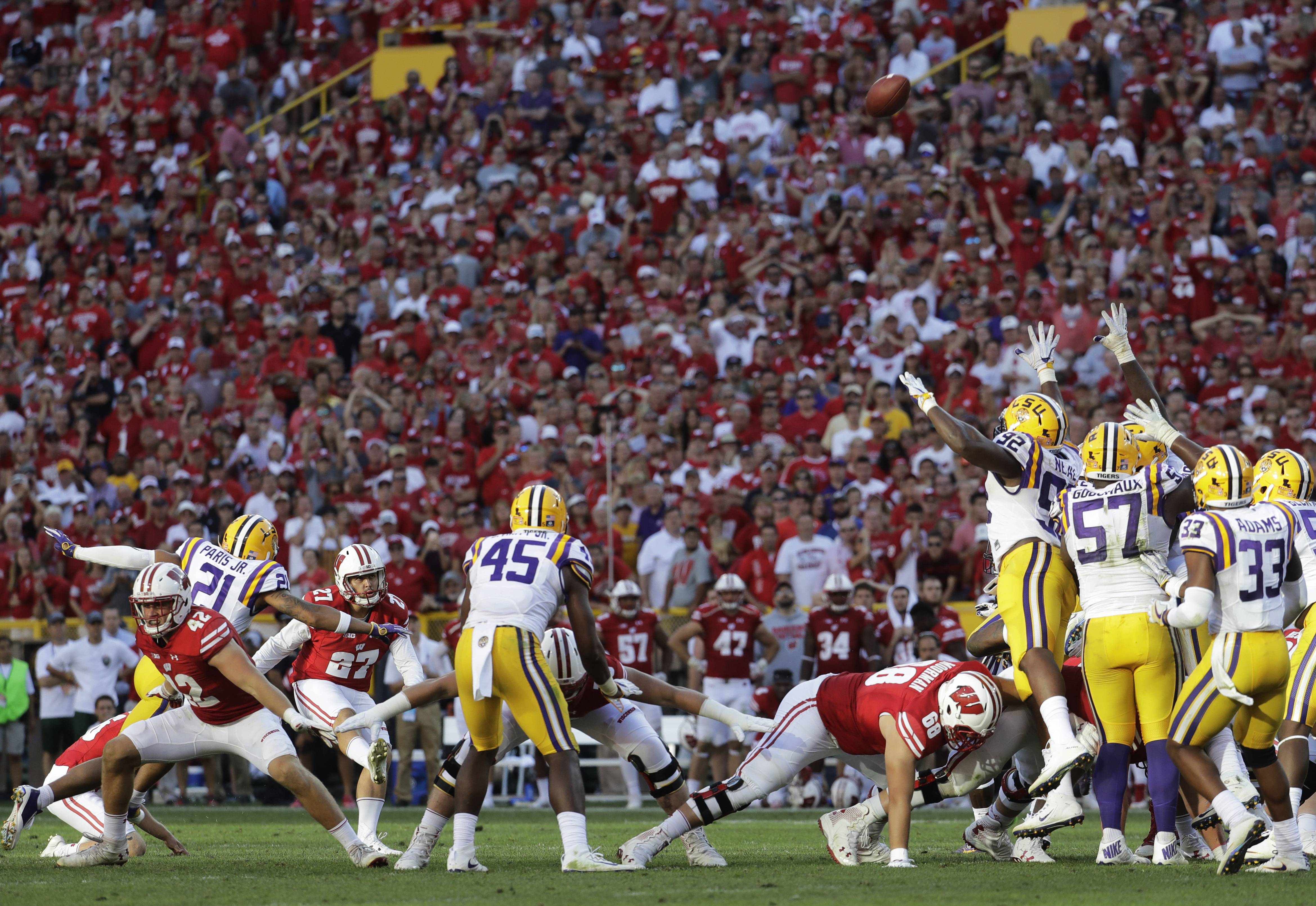 Wisconsin place kicker Rafael Gaglianone kicks a field goal with teammate Robert Wheelwright late in the second half of an NCAA college football game against LSU Saturday, Sept. 3, 2016, in Green Bay, Wis. Wisconsin won 16-14. (AP Photo/Morry Gash)