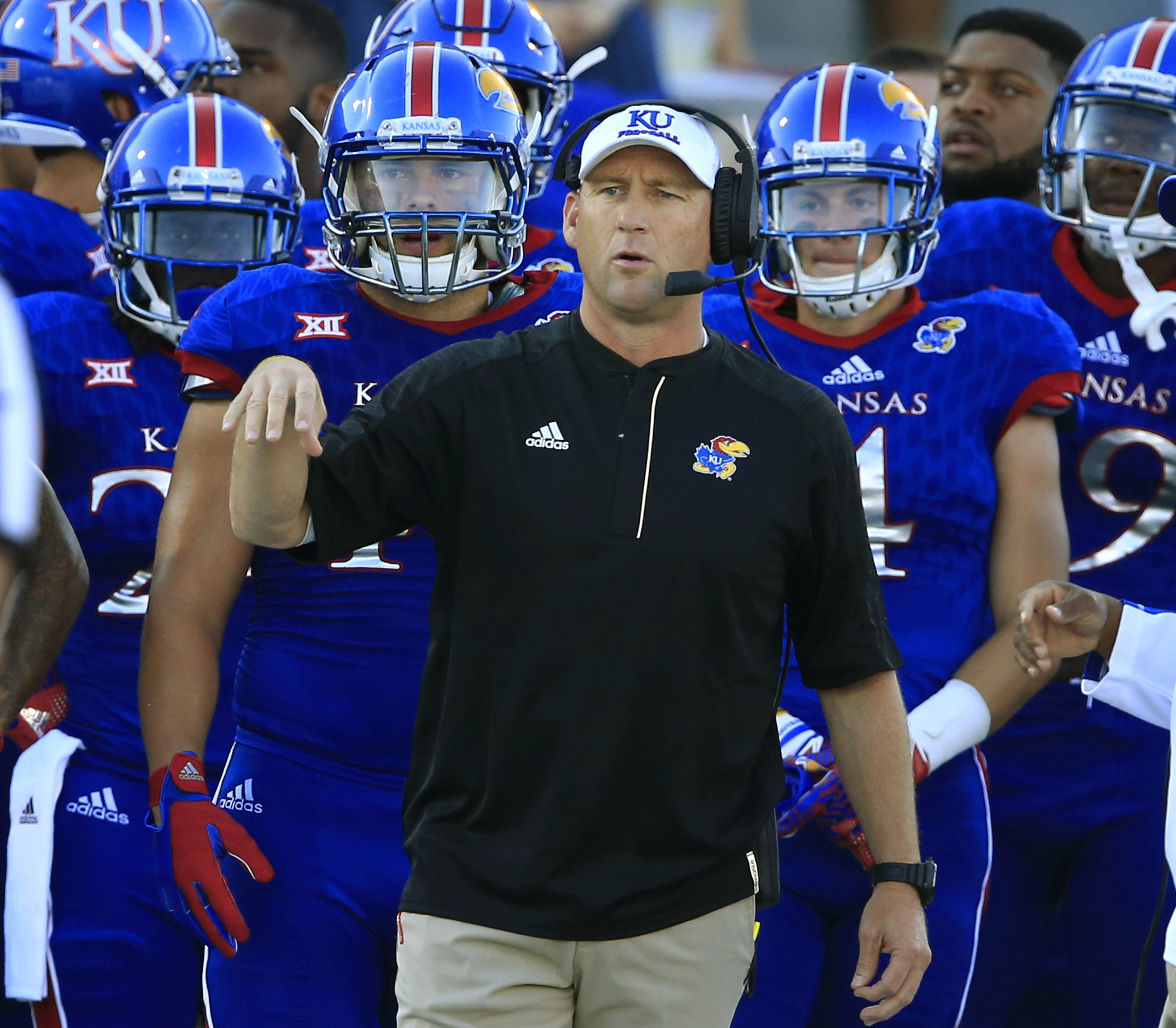 Kansas head coach David Beaty directs his team during the first half of an NCAA college football game against Rhode Island in Lawrence, Kan., Saturday, Sept. 3, 2016. (AP Photo/Orlin Wagner)