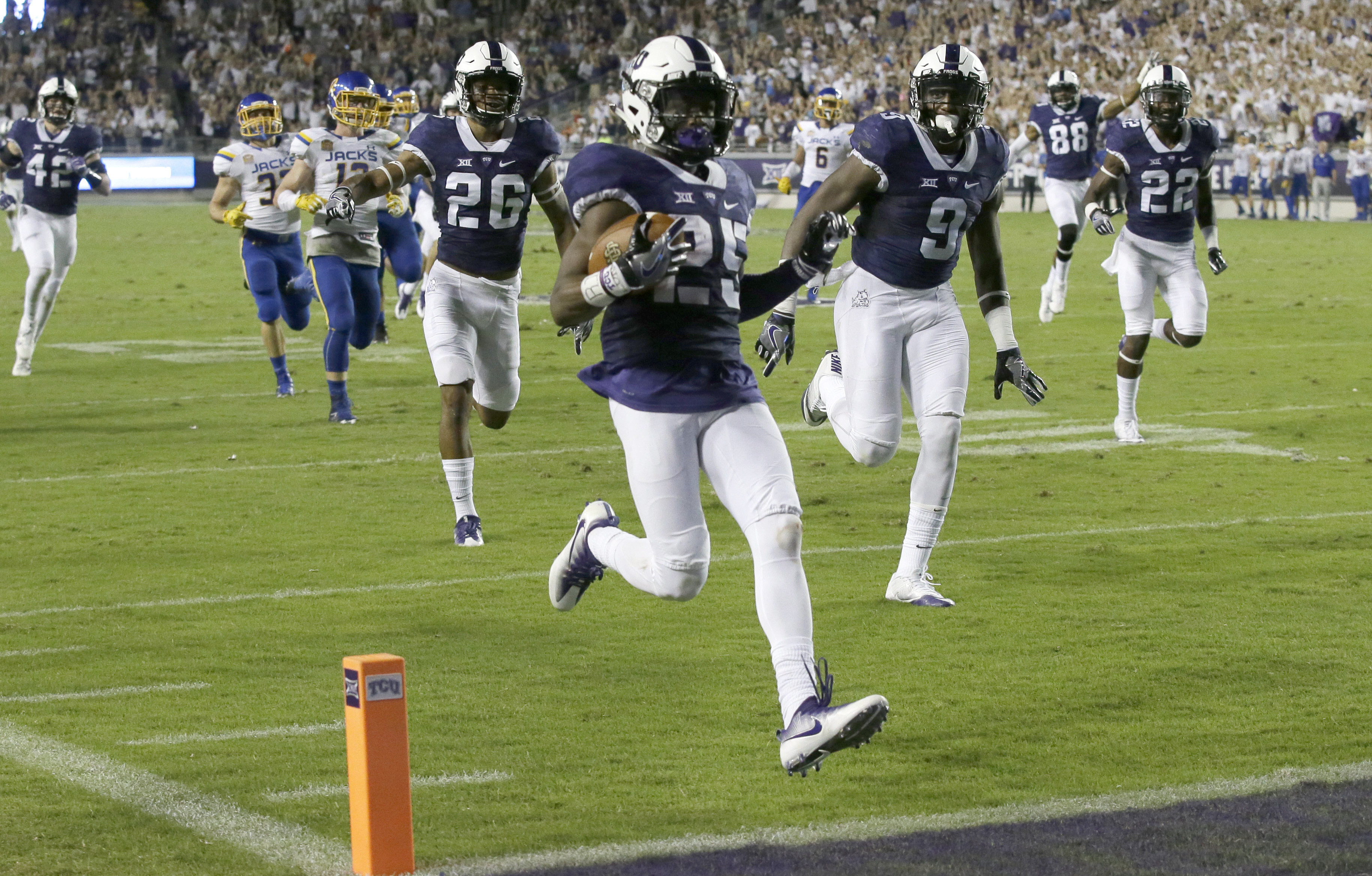 TCU punt returner KaVontae Turpin (25) runs a punt in for a touchdown during the first half of an NCAA college football game against South Dakota State on Saturday, Sept. 3, 2016, in Fort Worth, Texas. (AP Photo/LM Otero)