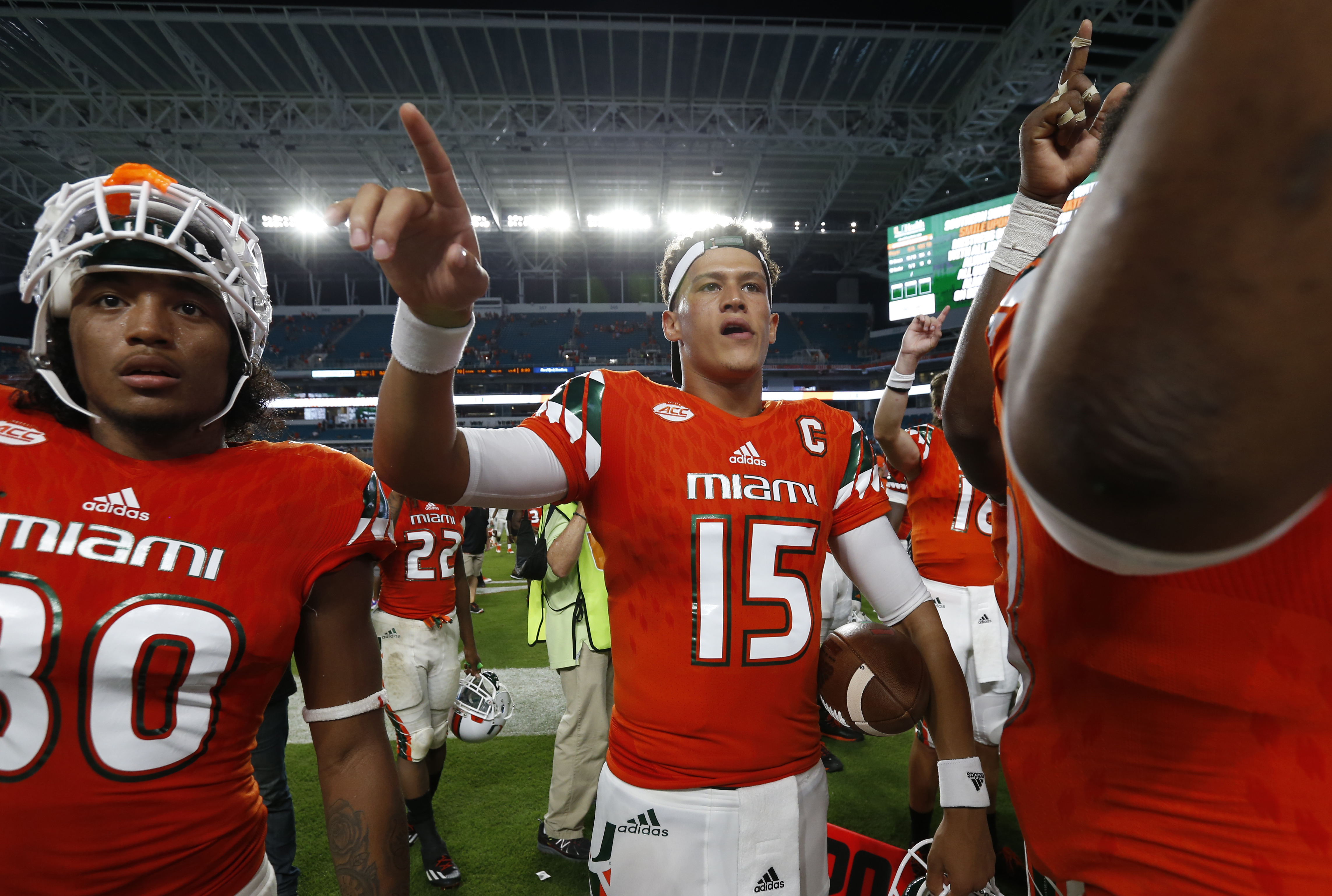 Miami quarterback Brad Kaaya (15) joins in singing the school song after Miami defeated Florida A&M 70-3 in an NCAA college football game, Saturday, Sept. 3, 2016 in Miami Gardens, Fla. Kaaya threw for four touchdowns on his 21st birthday and Miami scored