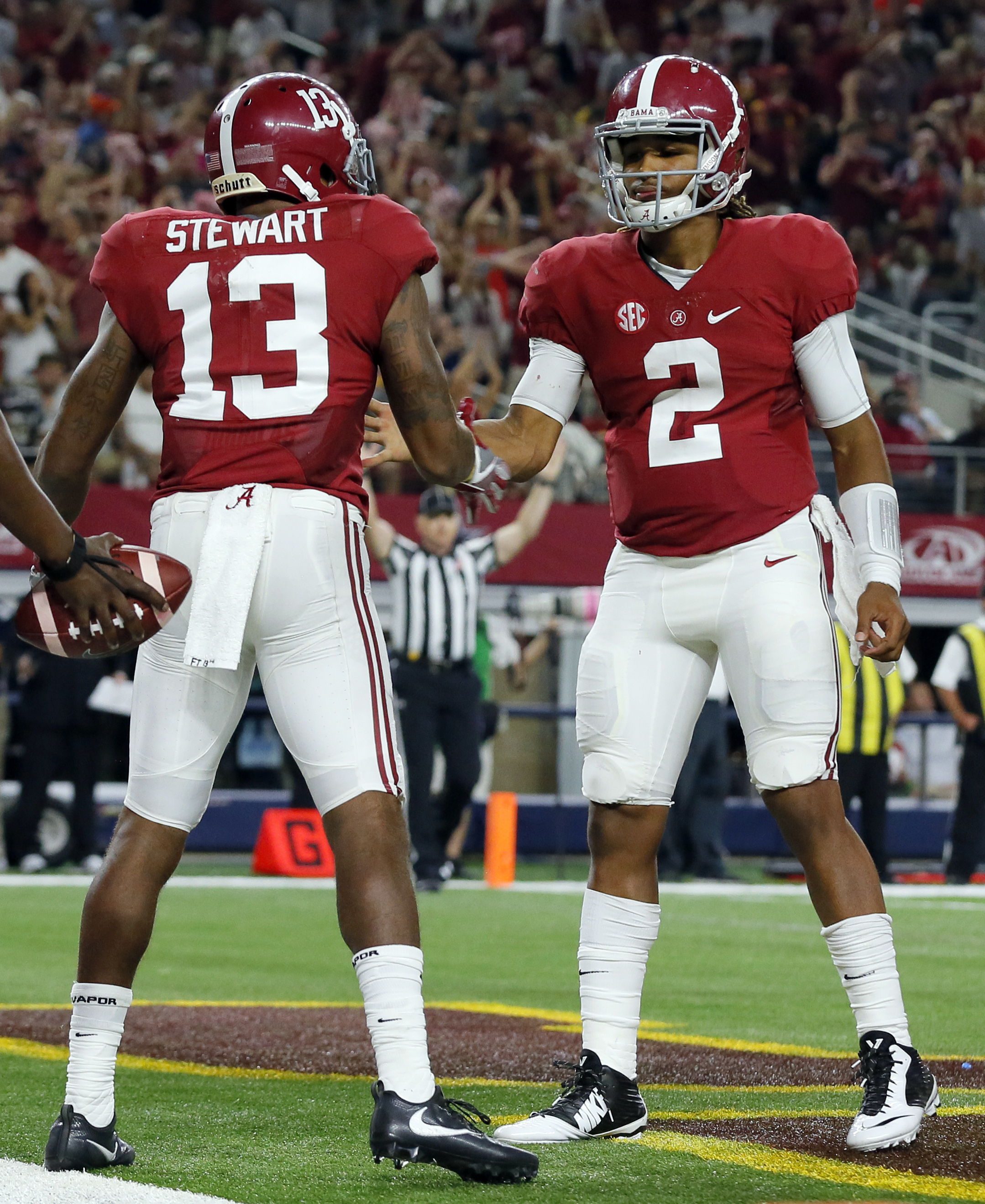 Alabama quarterback Jalen Hurts, right, is congratulated by teammate ArDarius Stewart after scoring on a 7-yard run during the second half of an NCAA college football game against Southern California on Saturday, Sept. 3, 2016, in Arlington, Texas. (AP Ph