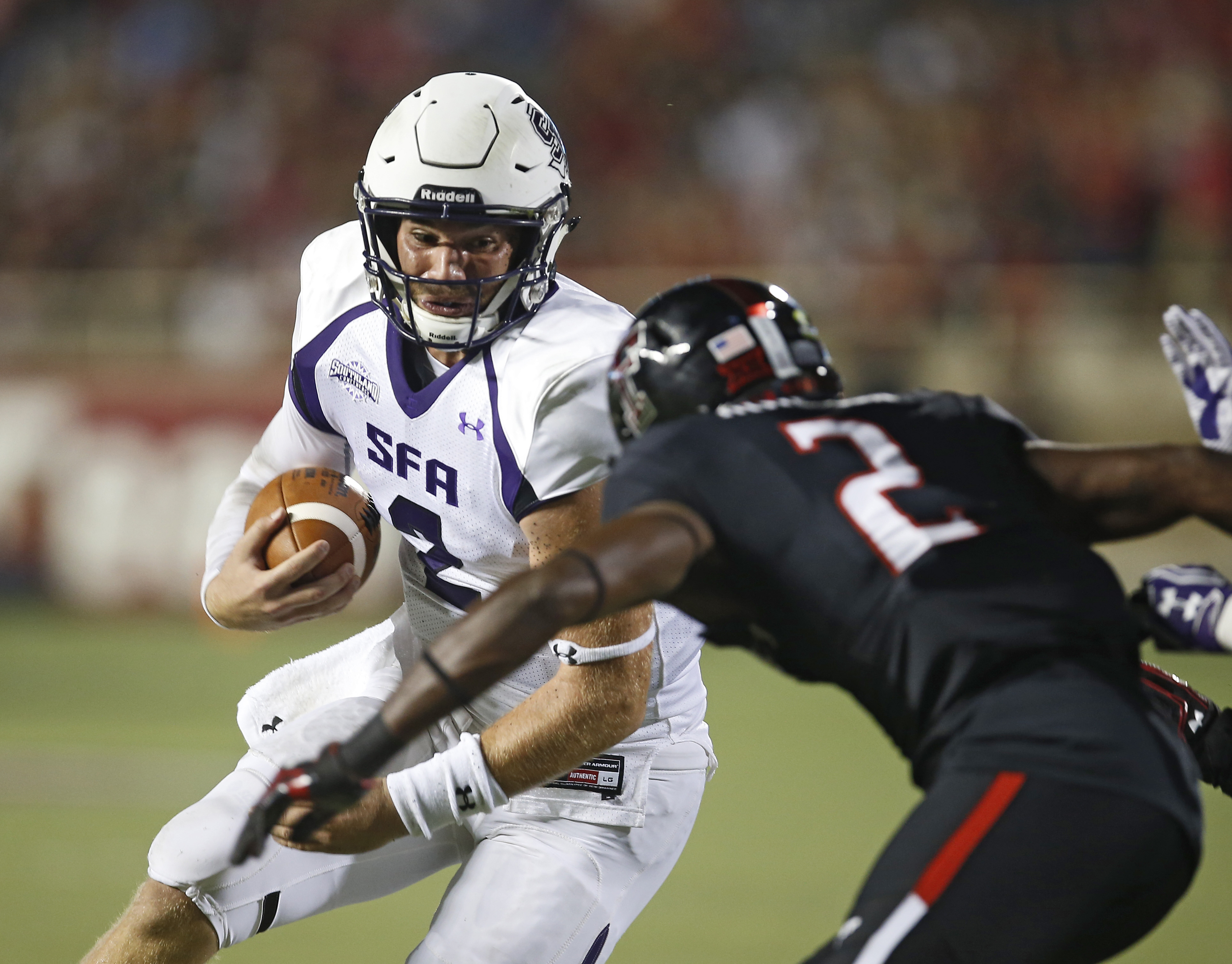 Stephen F. Austin's Zach Conque, left, tries to get around Texas Tech's Tevin Madison during an NCAA college football game Saturday, Sept. 3, 2016, in Lubbock, Texas. (Brad Tollefson/Lubbock Avalanche-Journal via AP)